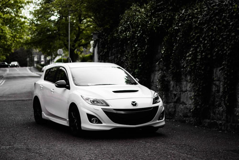 white Mazda 5-door hatchback