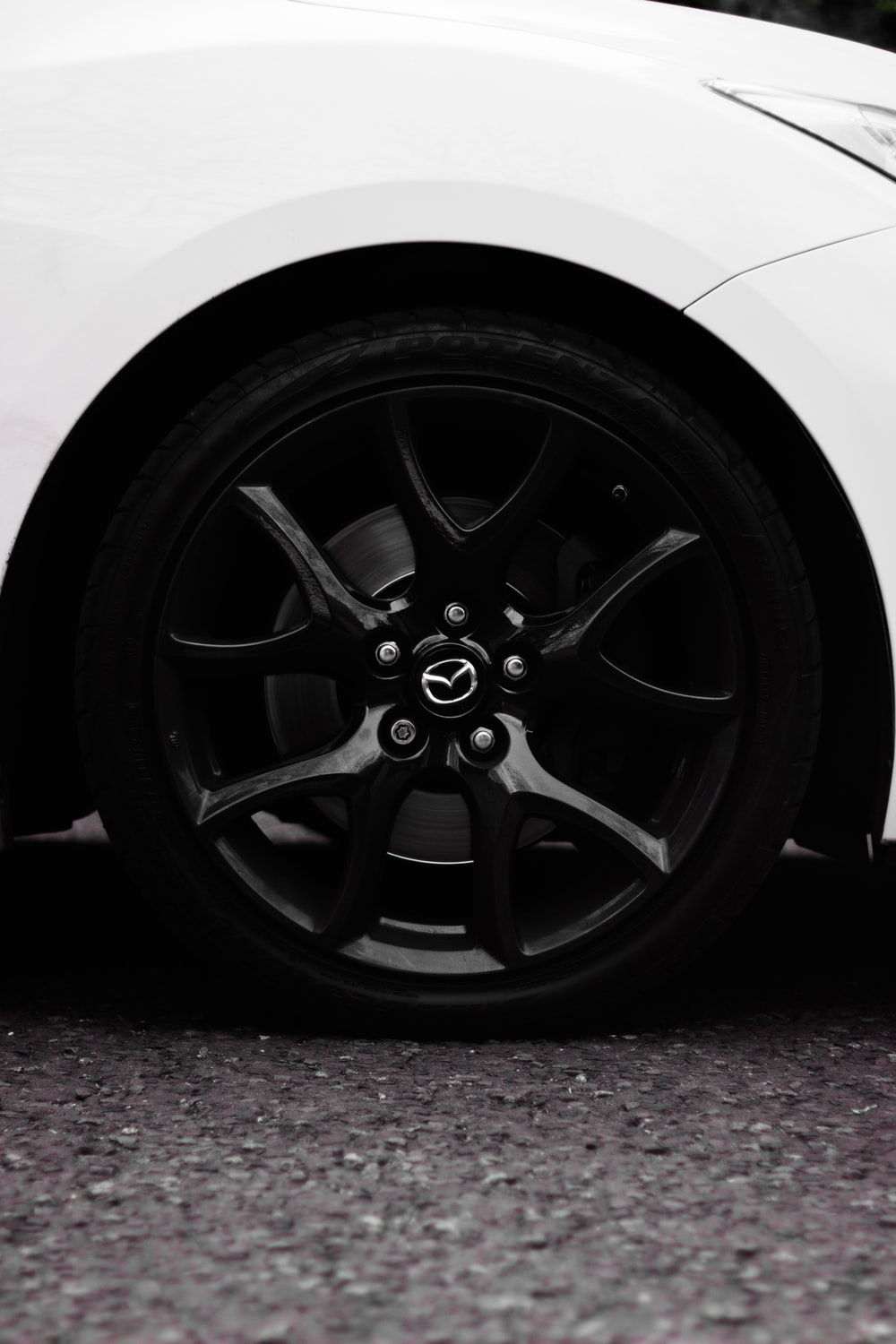 black vehicle wheel and tire