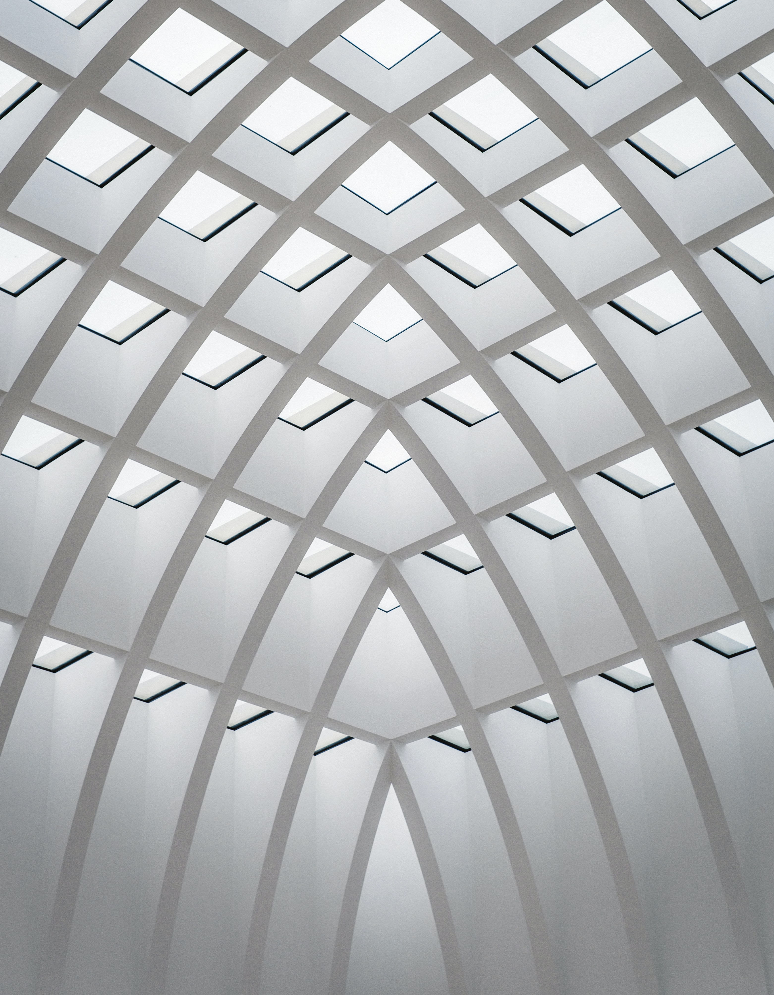 photo of white concrete building interior