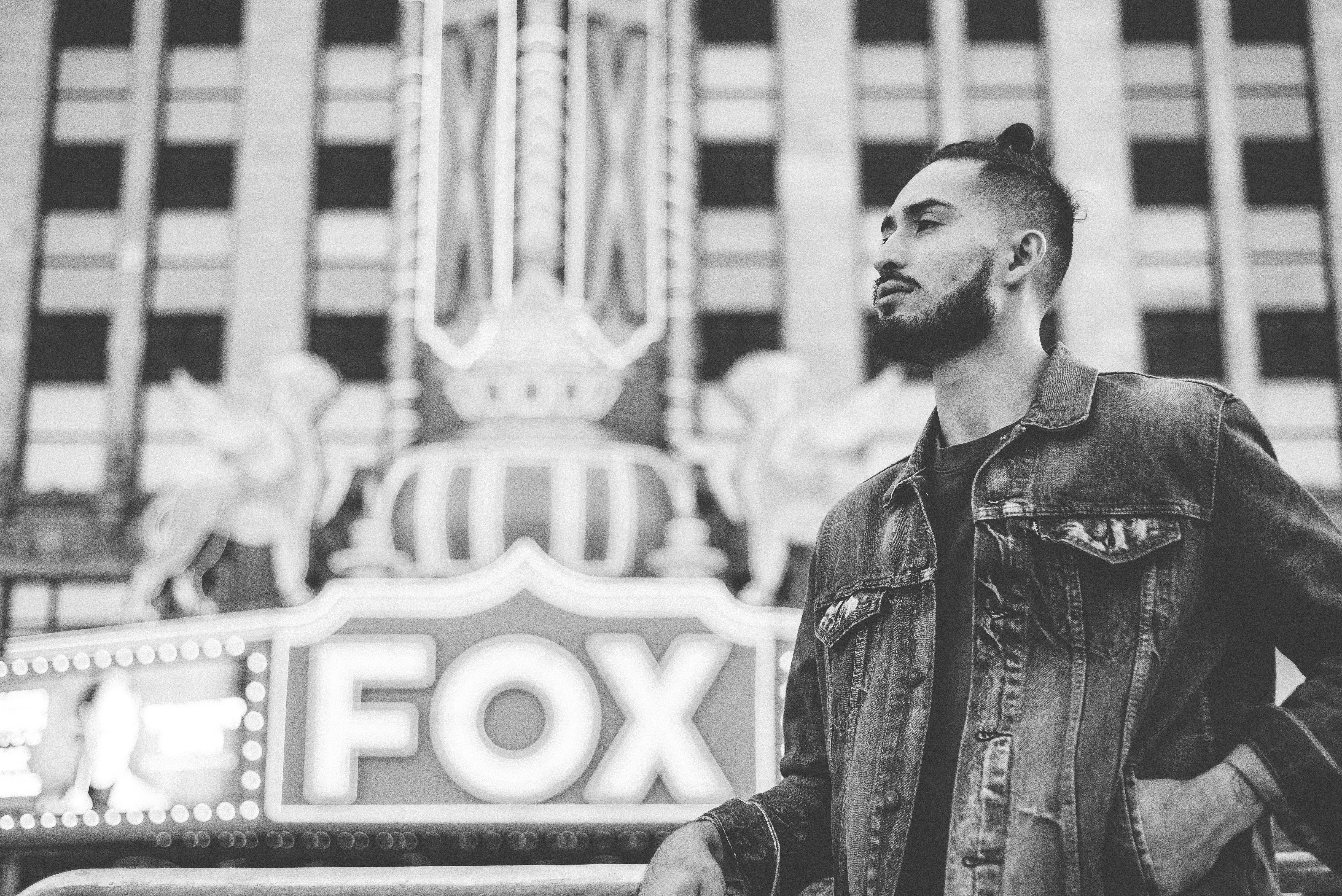 Black and white shot of young beared man in denim jacket at Fox Theatre