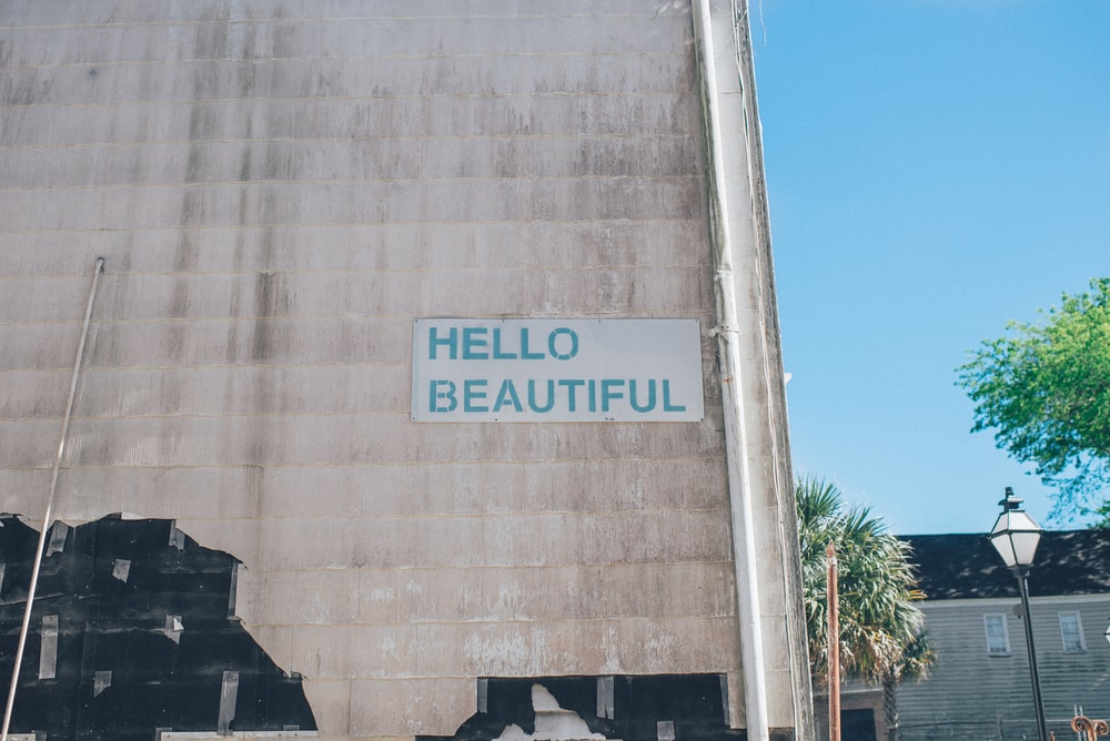 Hello Beautiful-printed brown concrete wall with near white wooden house
