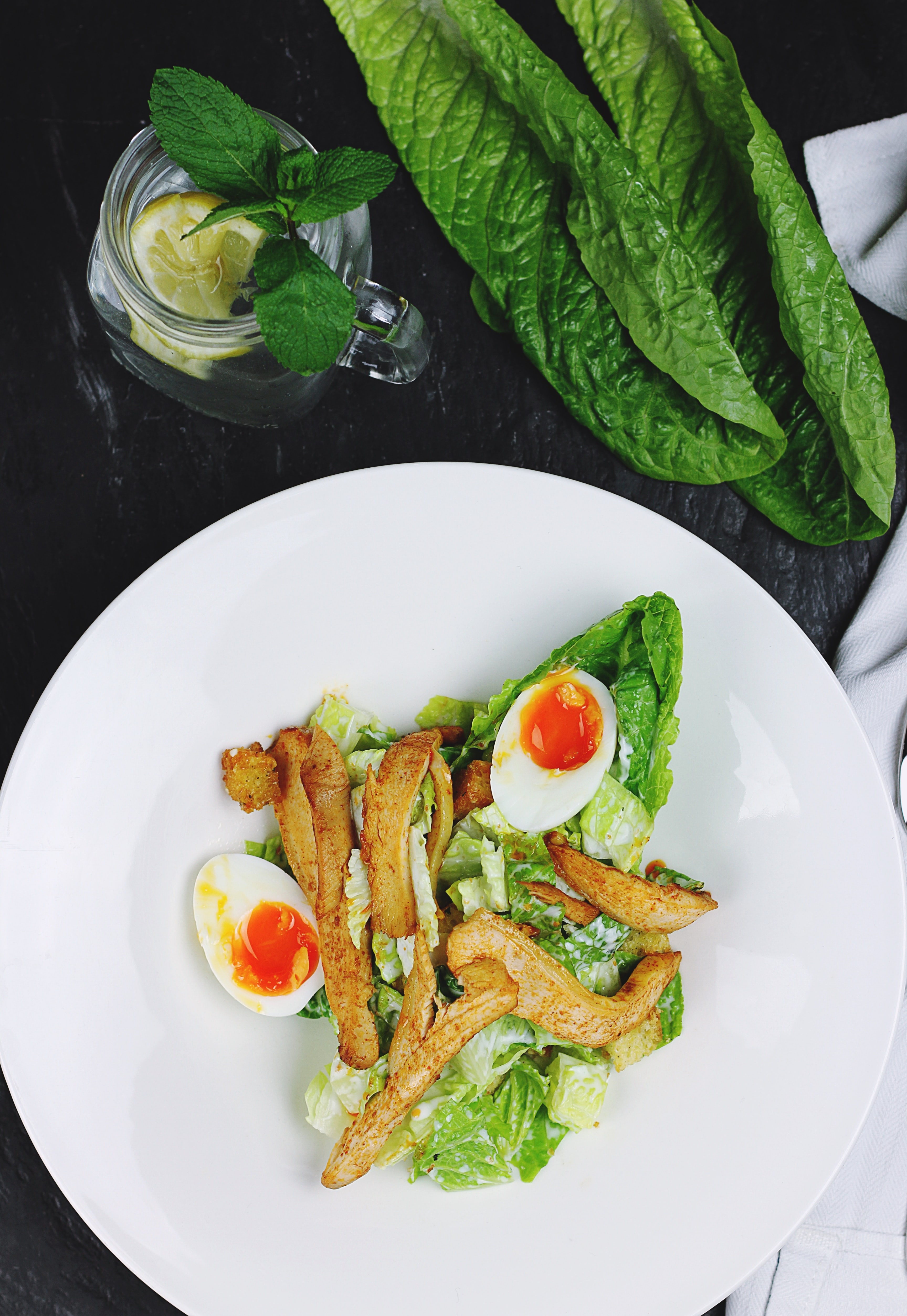 Salad with sauteed chicken, soft boiled eggs, and lettuce
