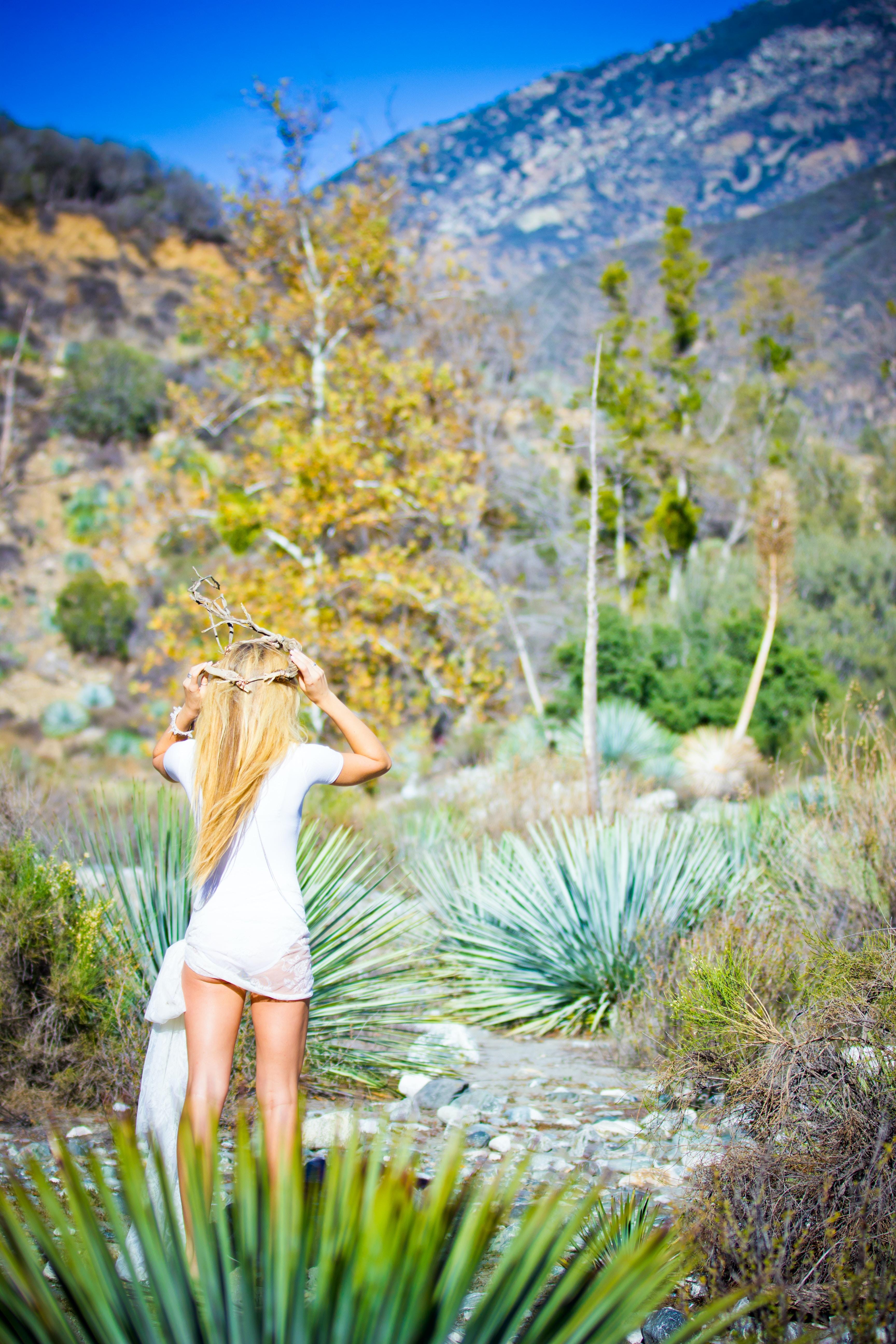 Bohemian dressed woman walks in the desert of Bridge To Nowhere Trailhead
