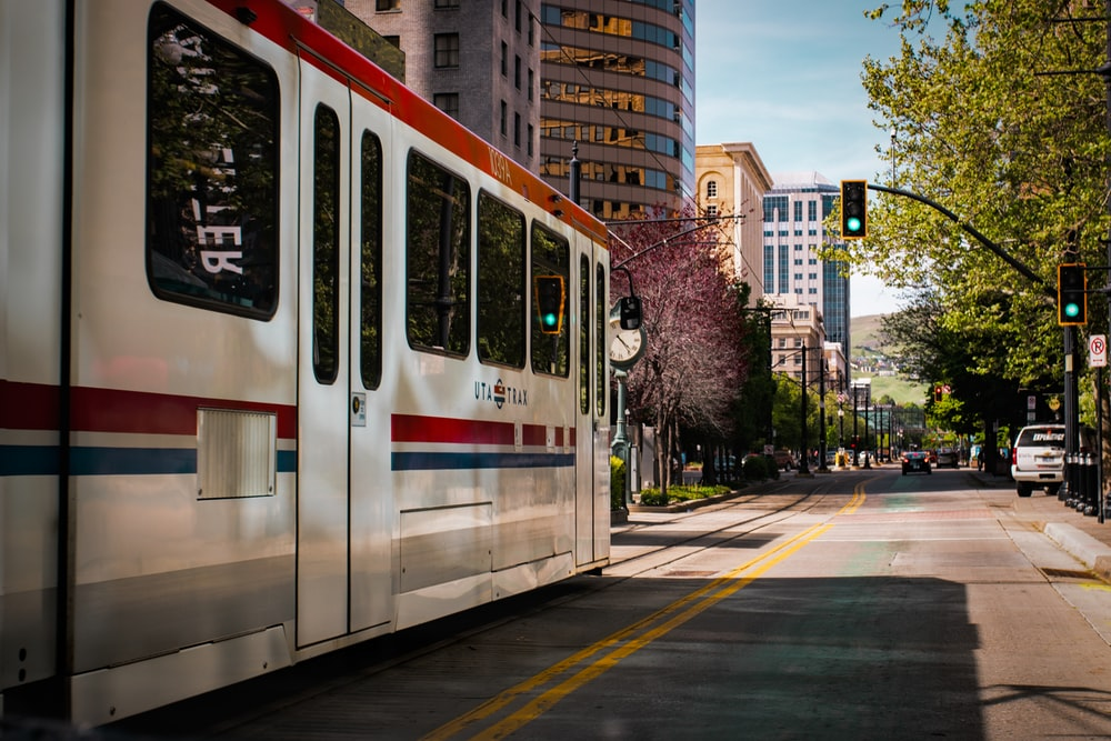 tram near buildings during daytime