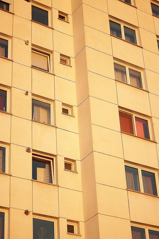beige concrete building with glass windows
