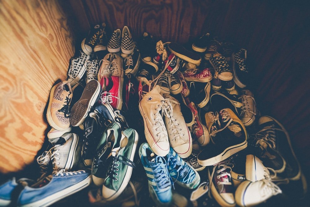 photography of assorted-color shoes lot on box