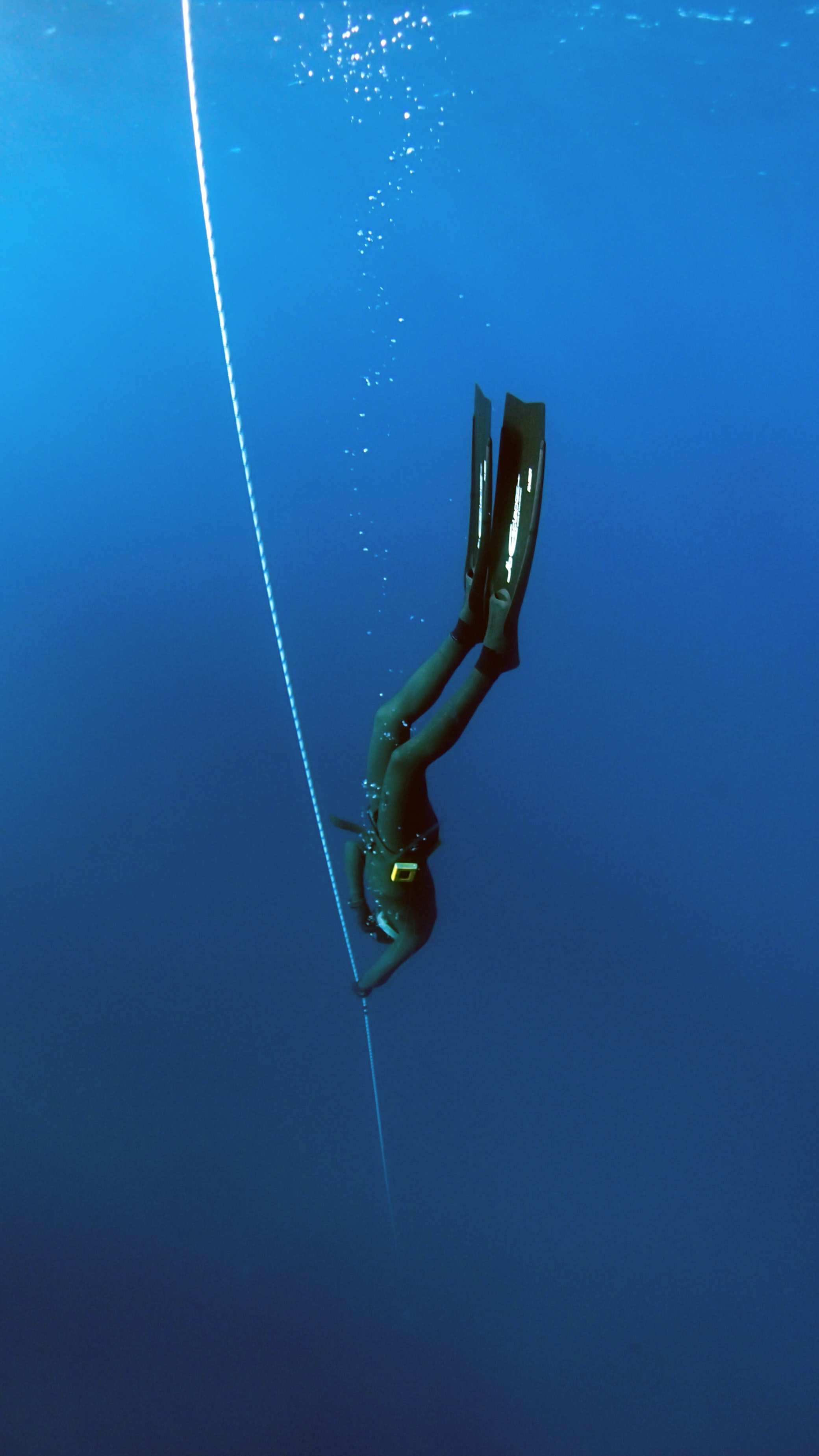 woman diving underwater