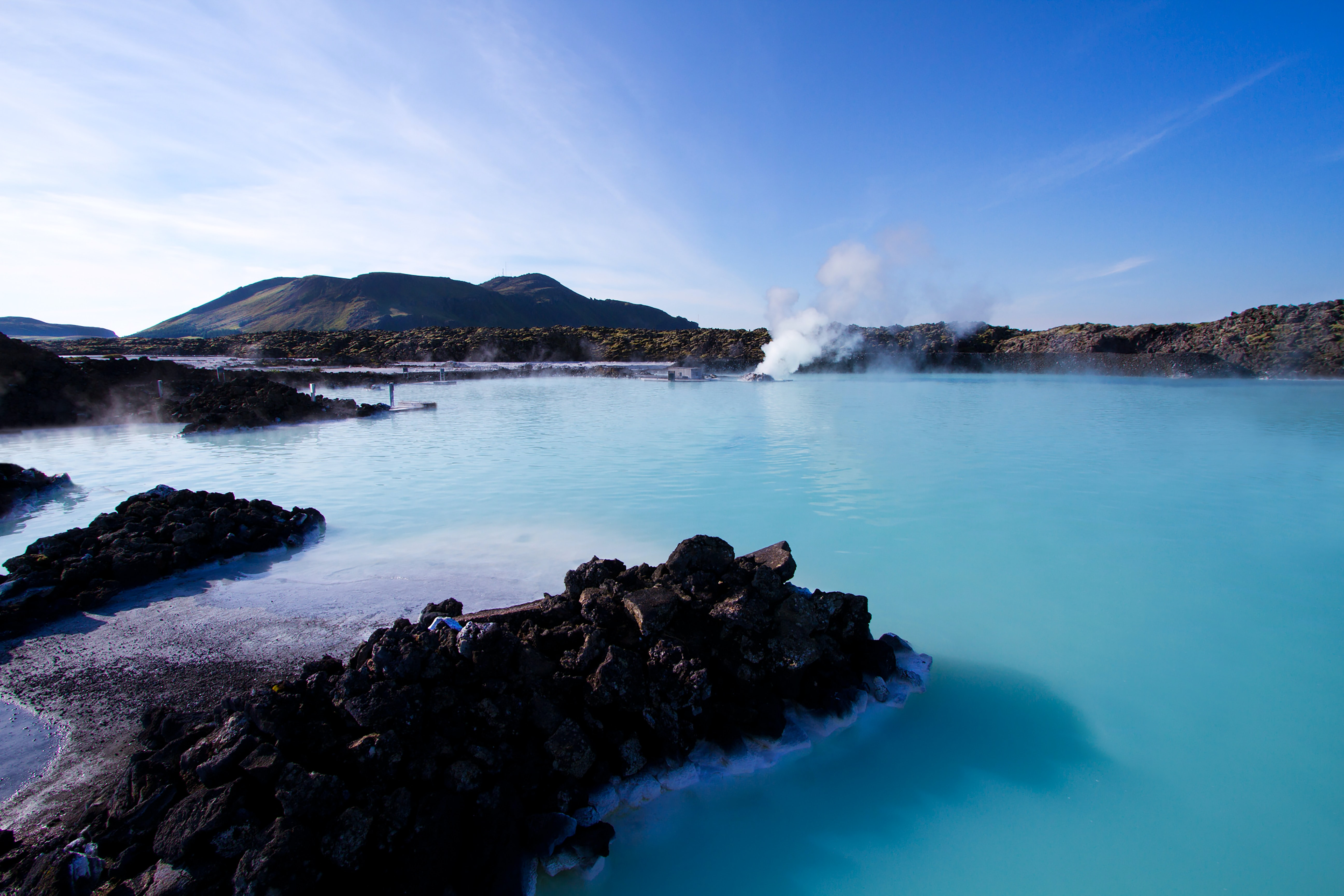 Clear blue water and sky with hot rock spring in Blue Lagoon spa, Reykjavik Iceland