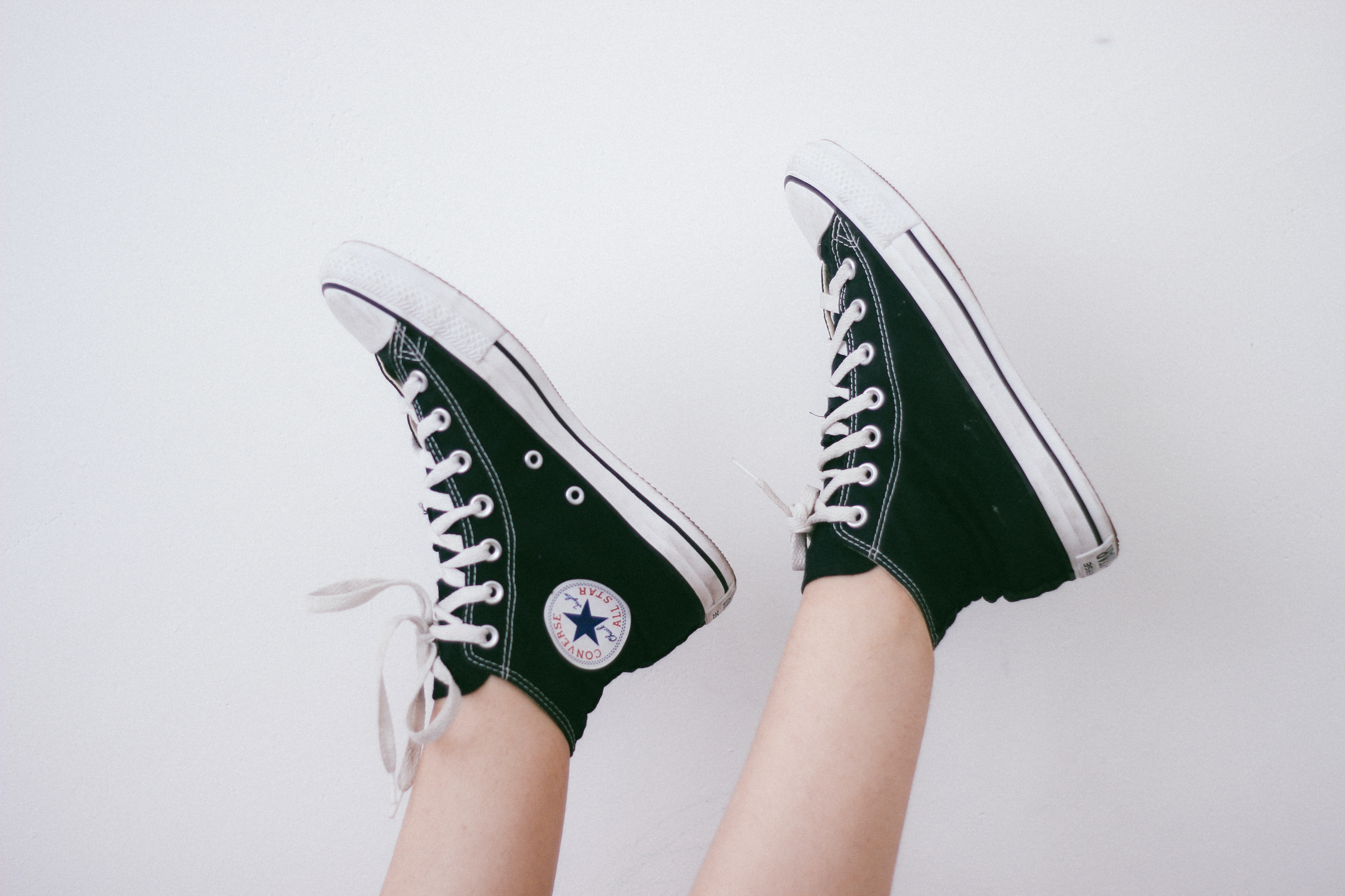 black and black and white Converse All Star high-top sneakers