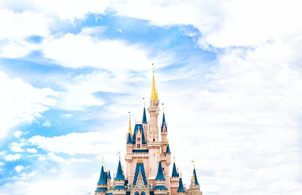 landscape photography of Walt Disney castle under cloudy sky