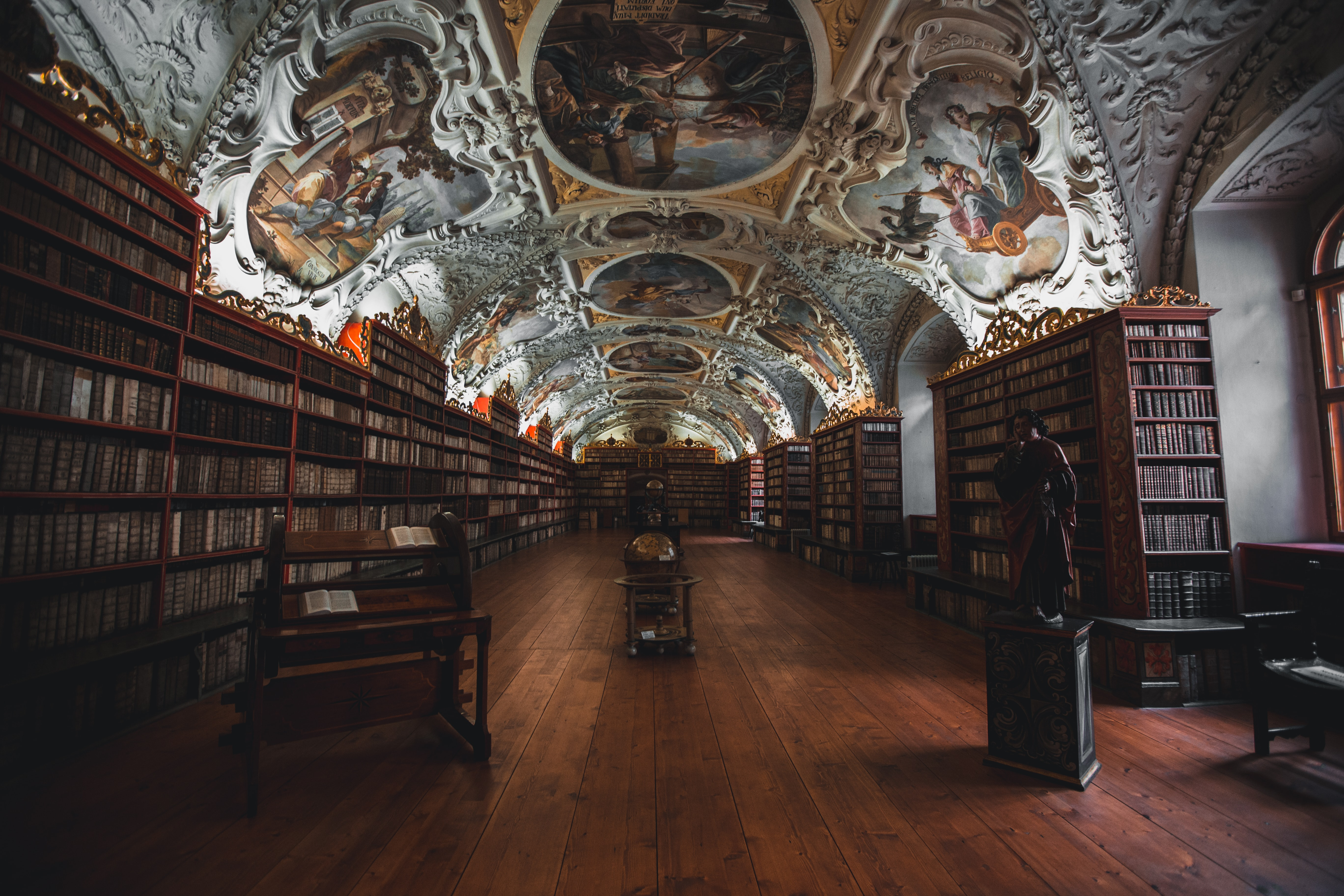 A library with a beautifully painted ceiling in Prague