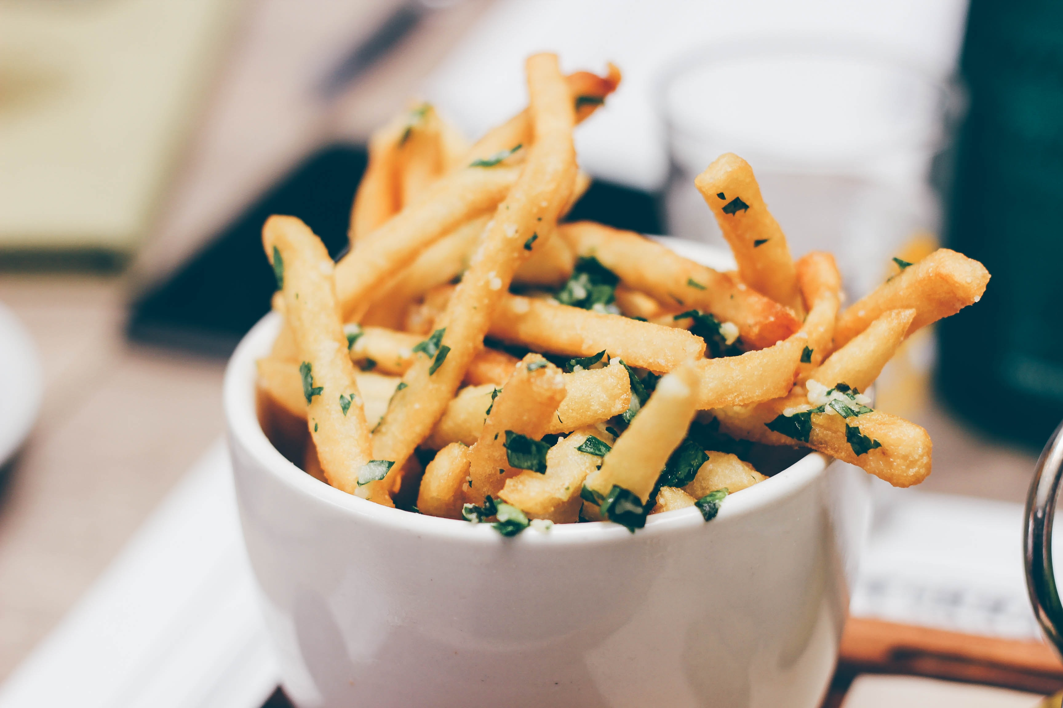 Cup of truffle french fries with herbs and garlic at a restaurant