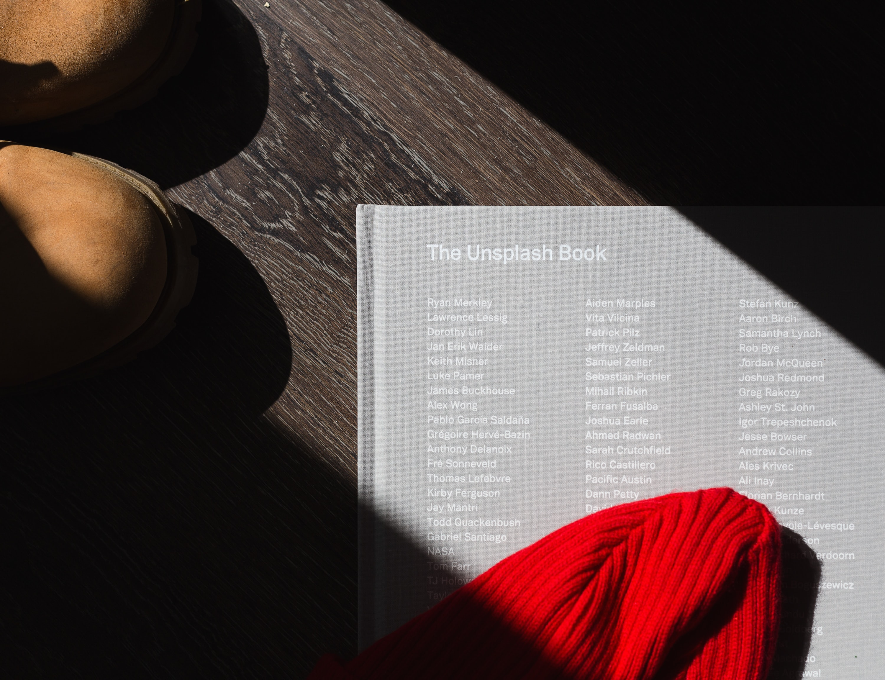 photo of The Unplash book on brown wooden surface