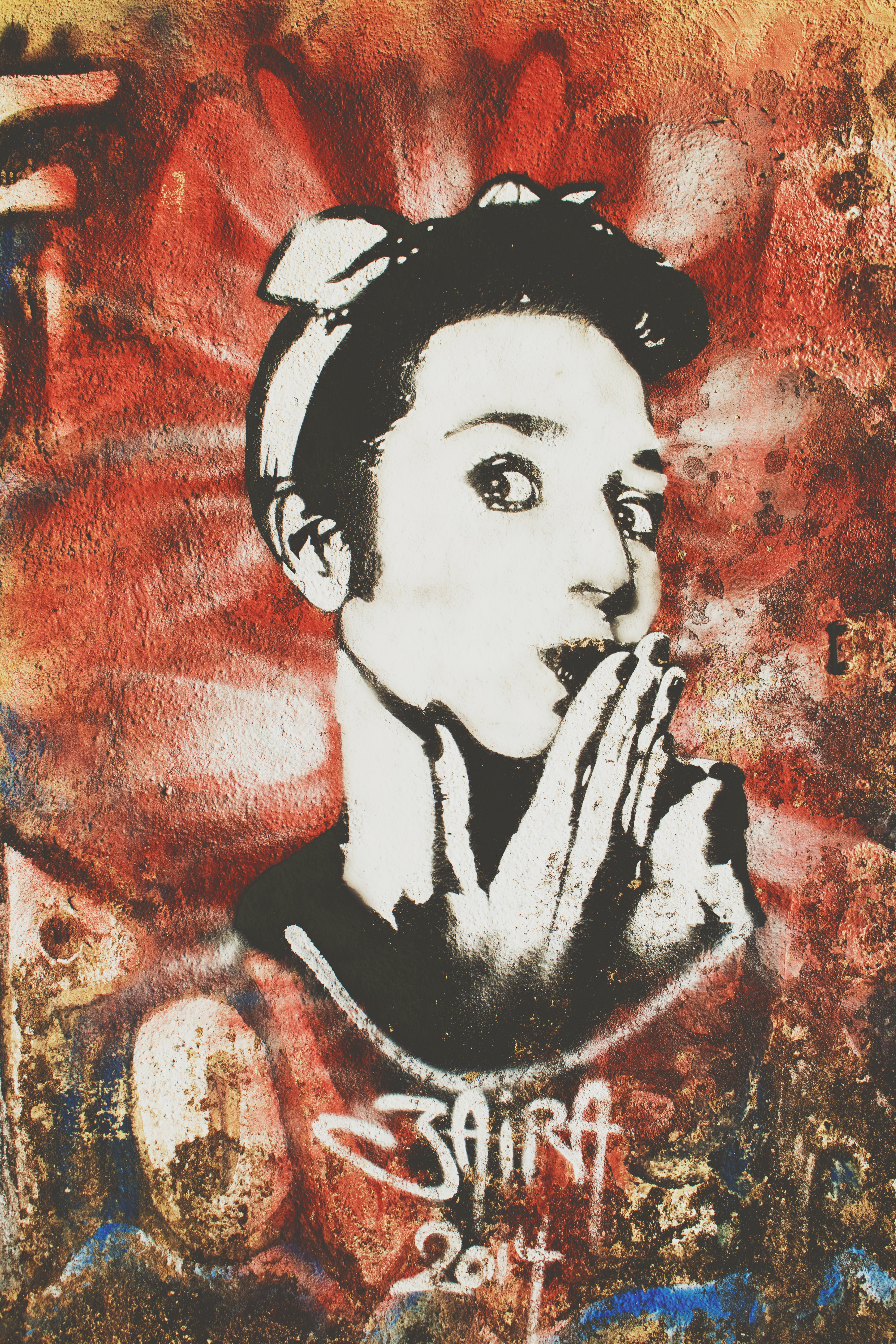 Black and white graffiti artwork of woman blowing kiss on red, Indian Institute of Technology Bombay