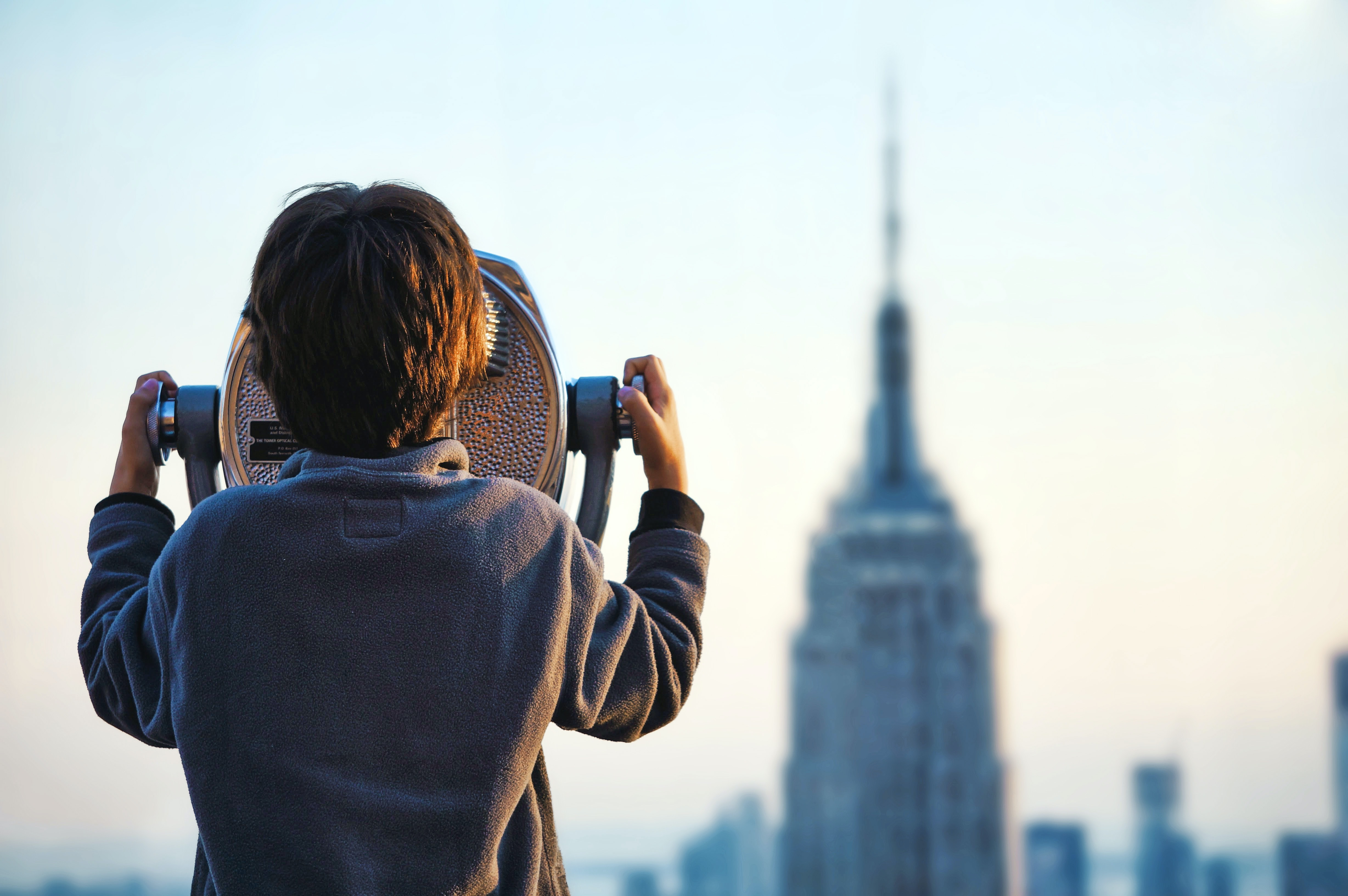 A child looking through a tower viewer in New York