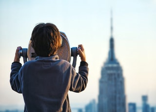child looking at Empire State building through tower viewer