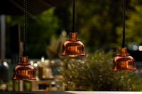photo of brown 3-bulb pendant lamps