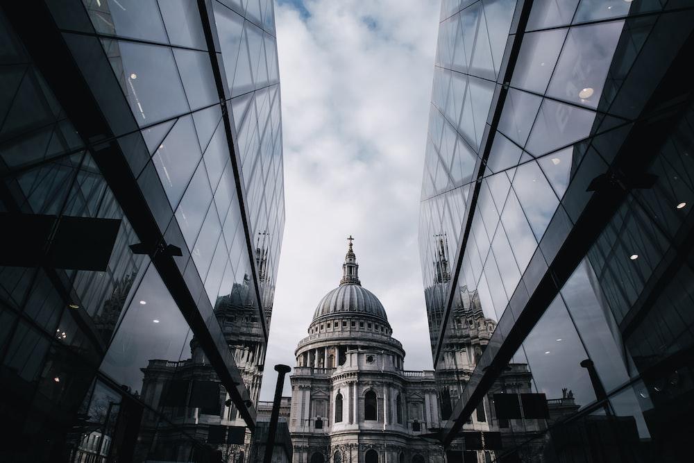 church between mirror-curtain buildings