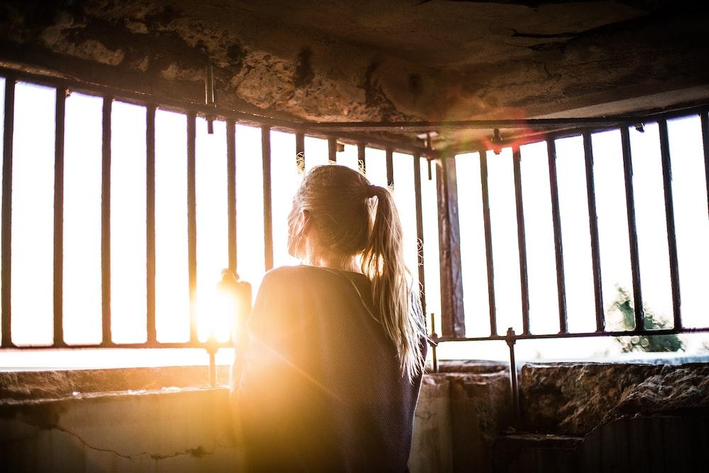 woman behind the bars