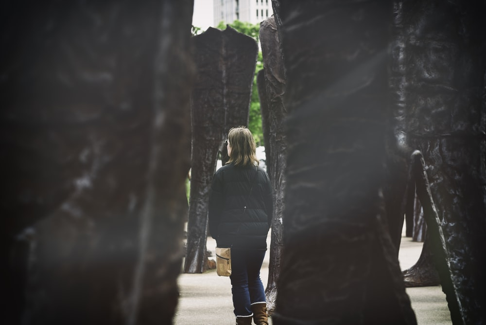 woman standing beside monument