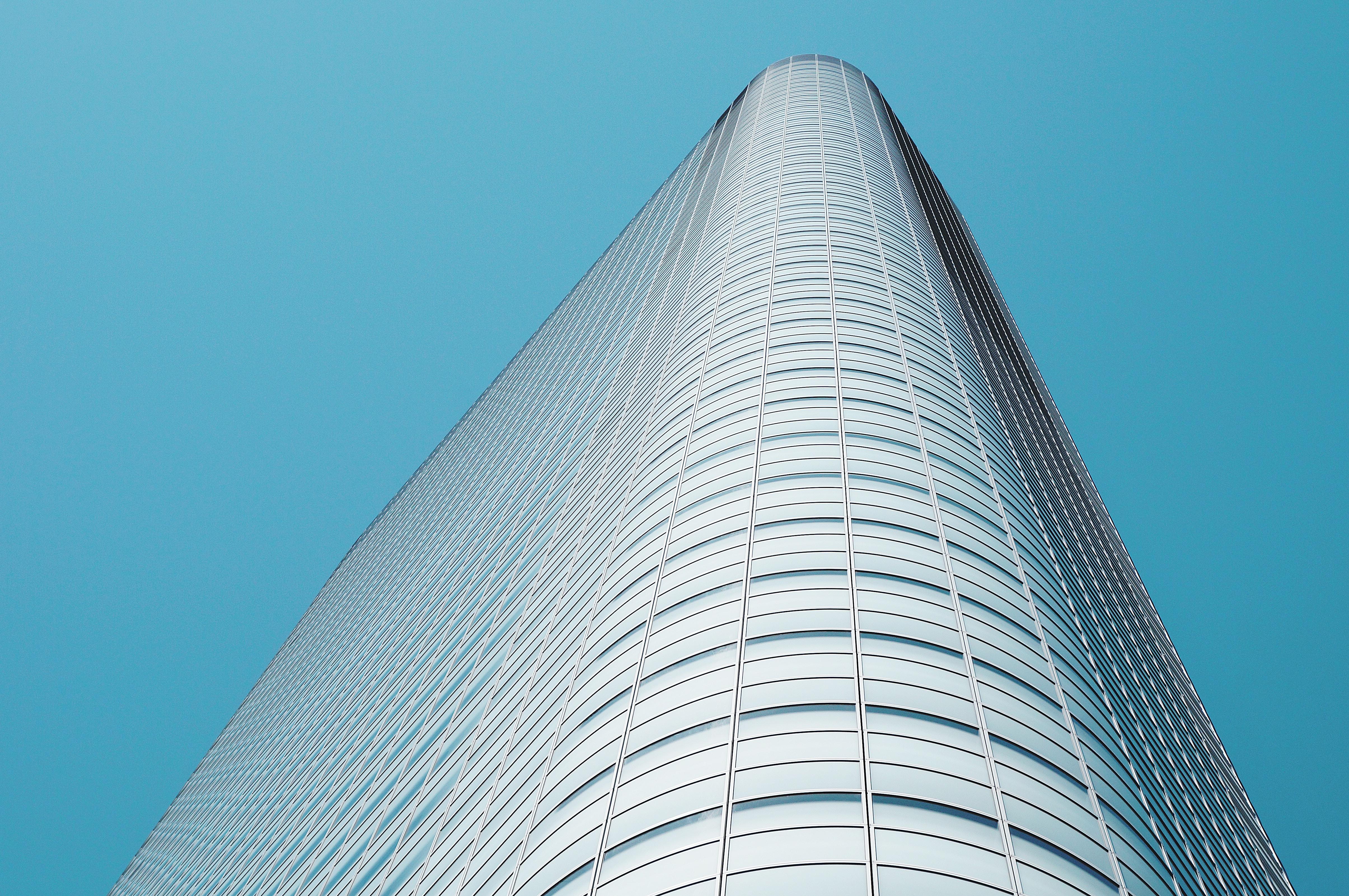 A round corner of a tall skyscraper in Tokyo