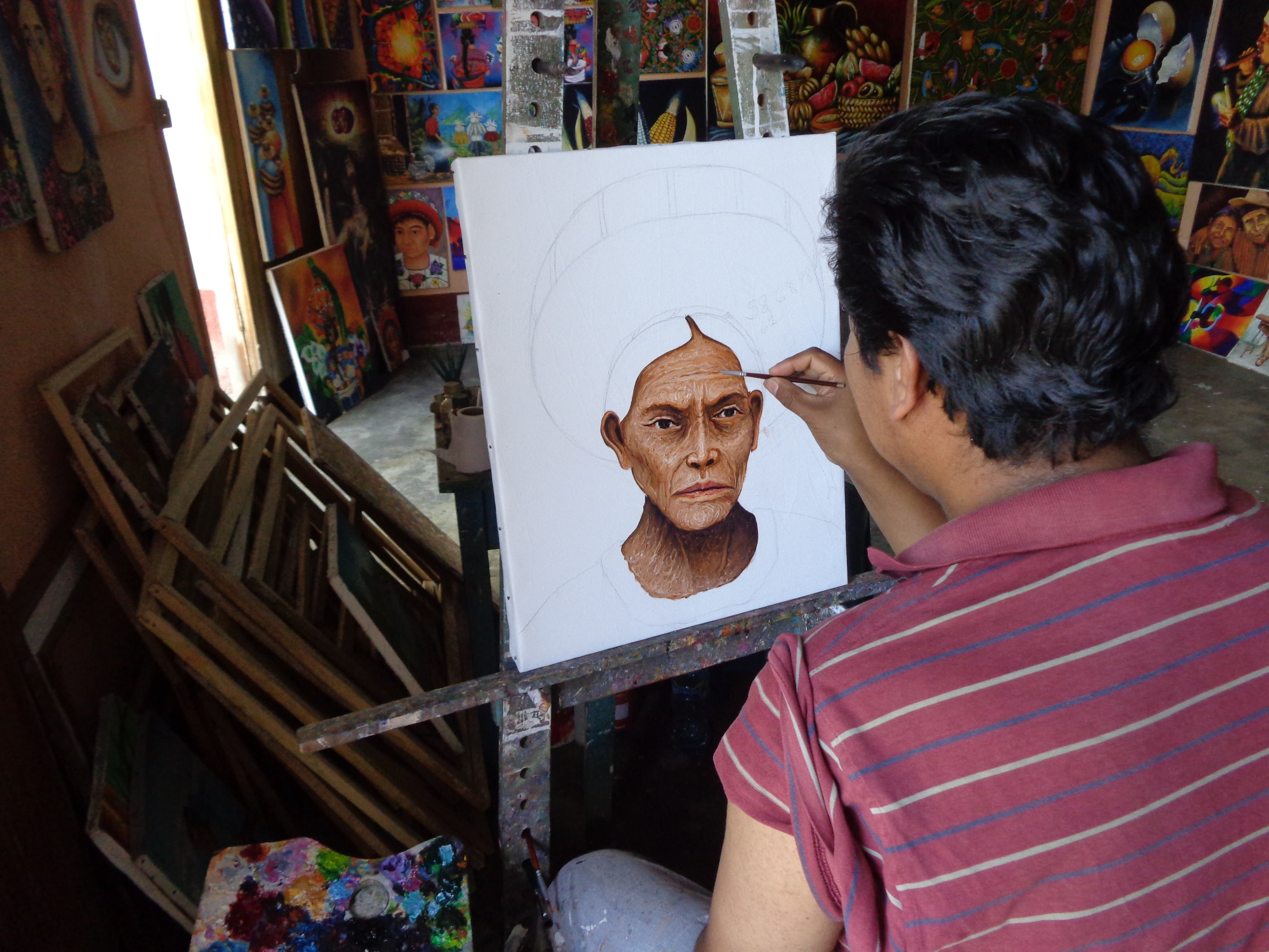 A man making a portrait of another person.