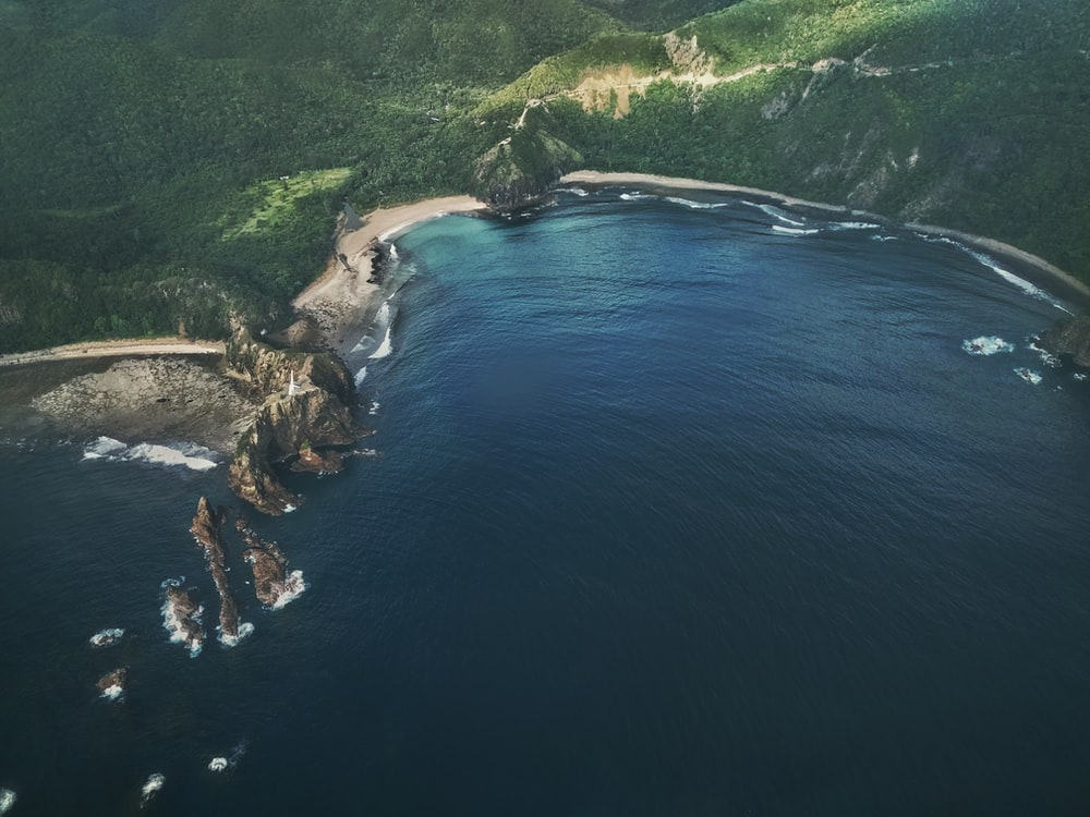 aerial photograph of sea and island