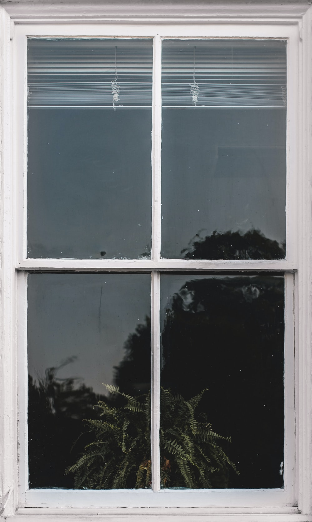 white wooden frame glass panel window with white window blinds