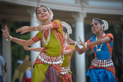 three woman performing traditional dance india teams background