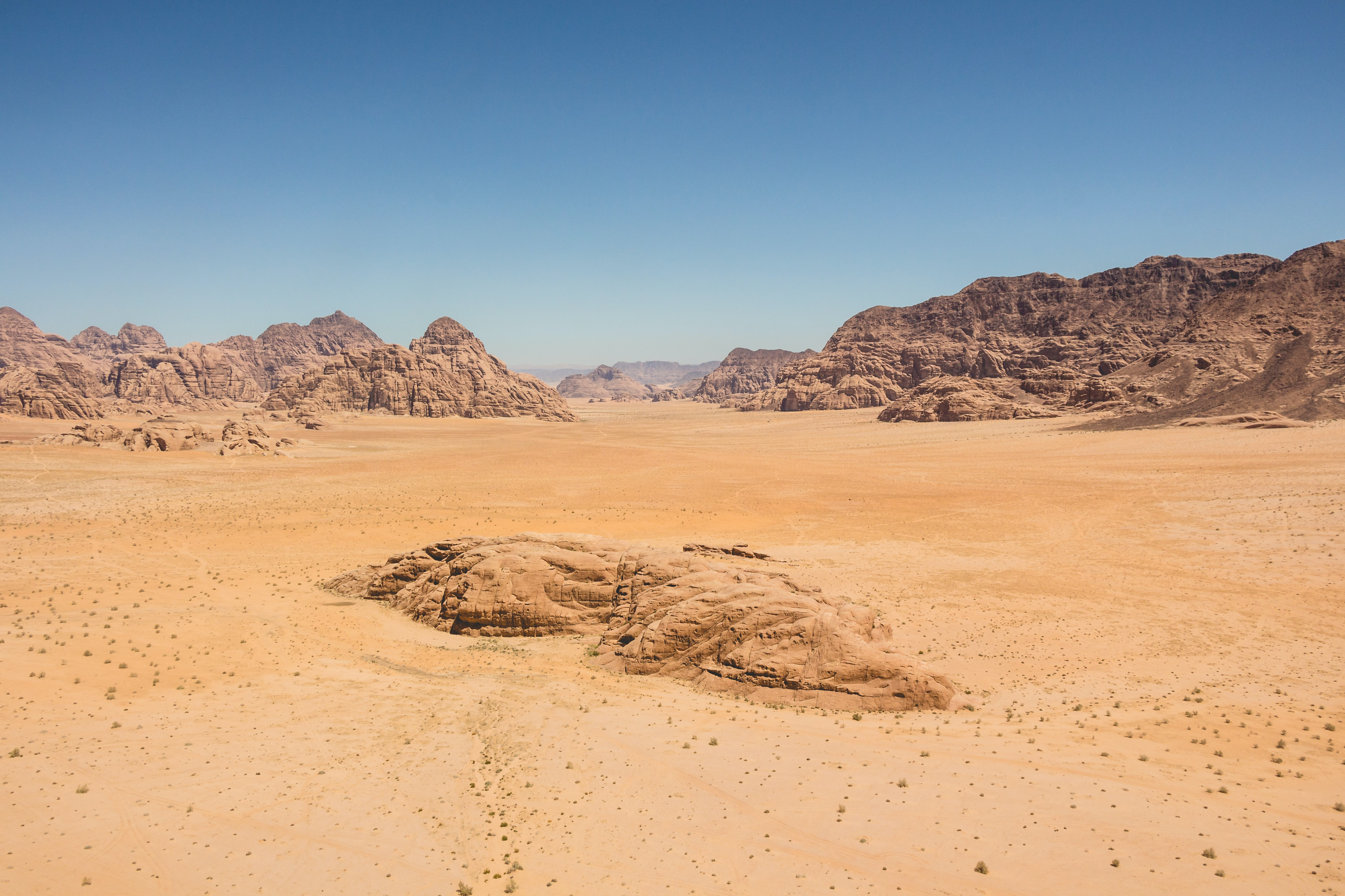 Rocky and barren sandy desert with clear blue sky at Wadi Rum
