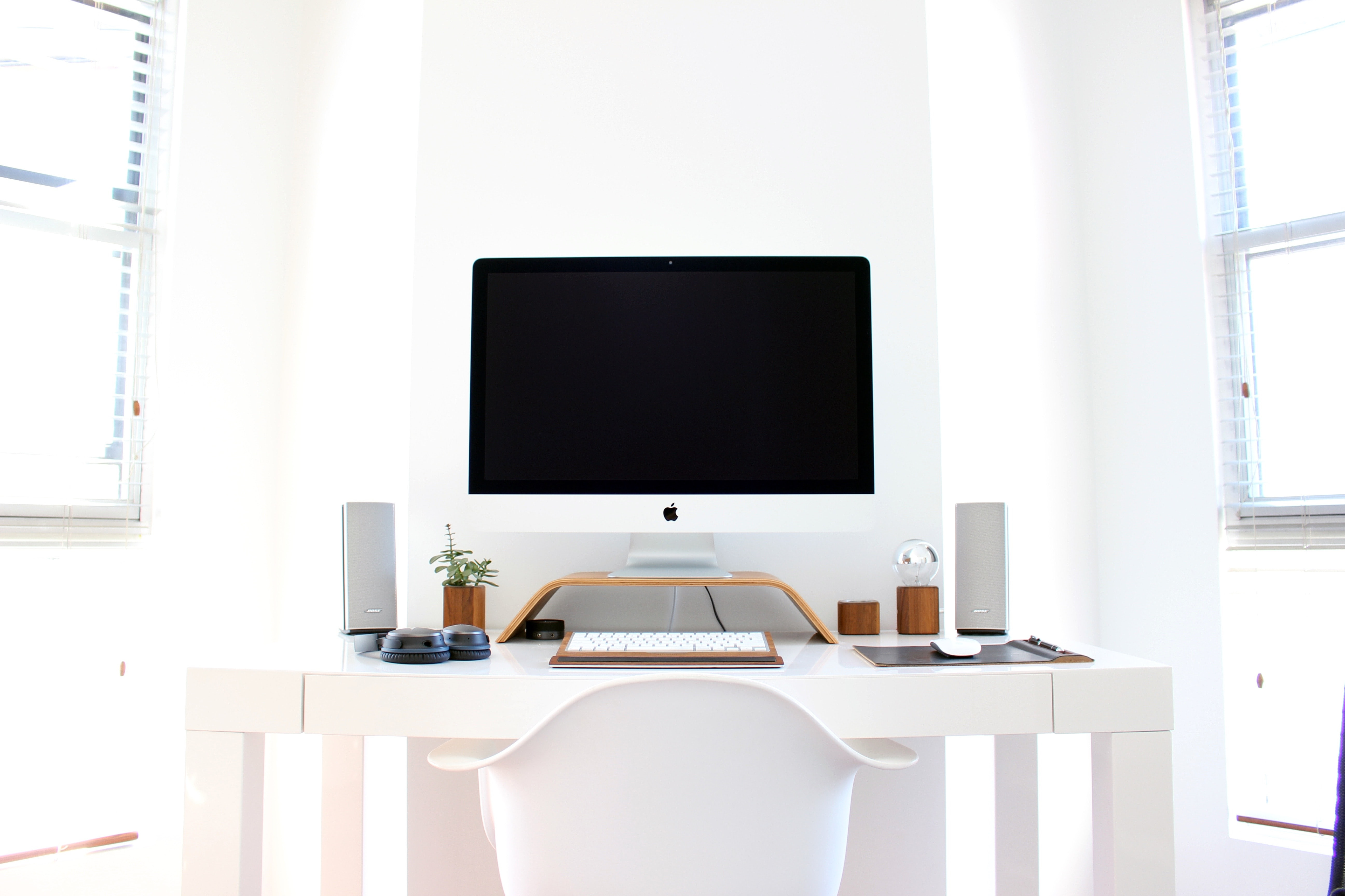 An orderly computer workspace with an iMac