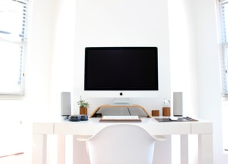 iMac on top of table