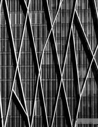 Black and white shot of building wall with modern abstract design and lines in Barcelona