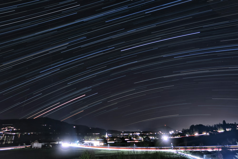 time lapse photography of city lights during night time