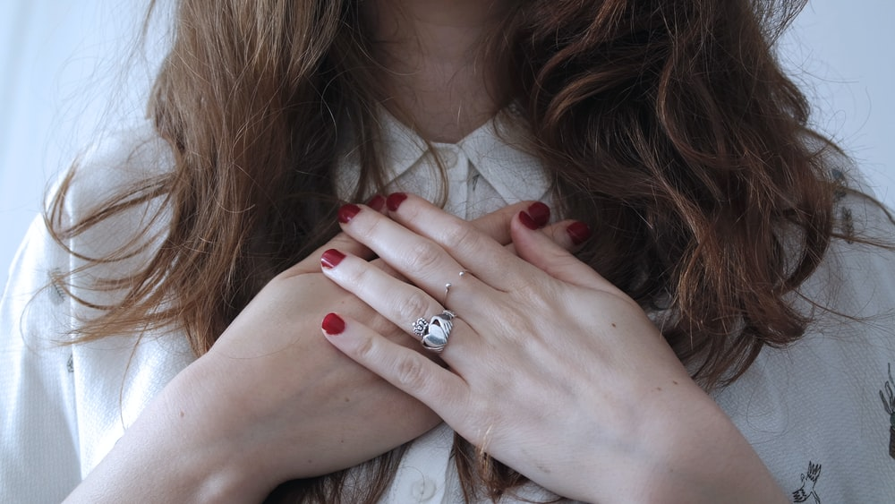 woman wearing silver-colored ring