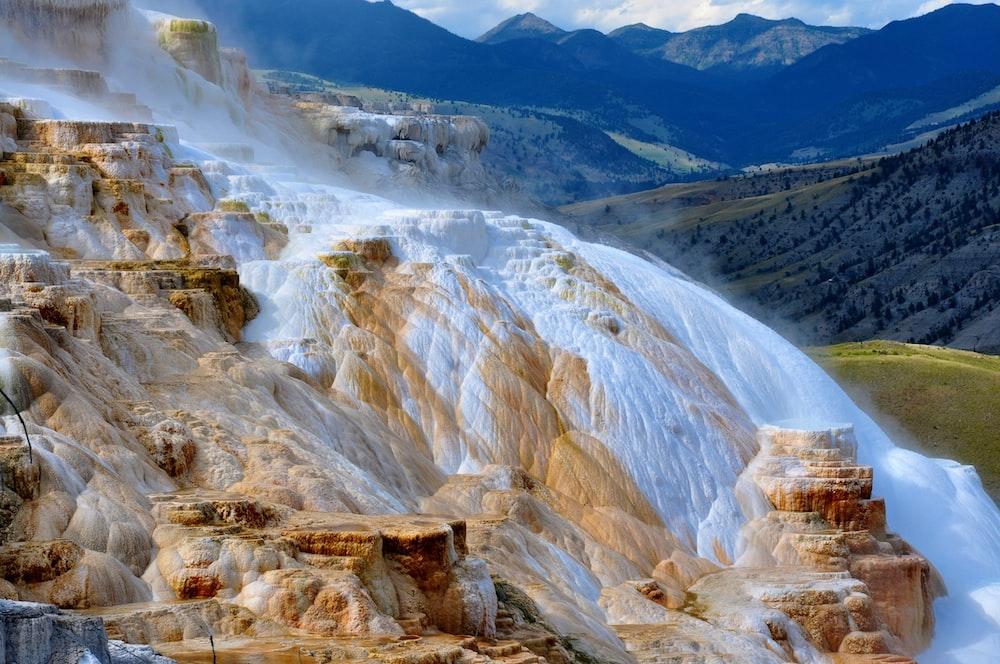 waterfalls on brown surface photo
