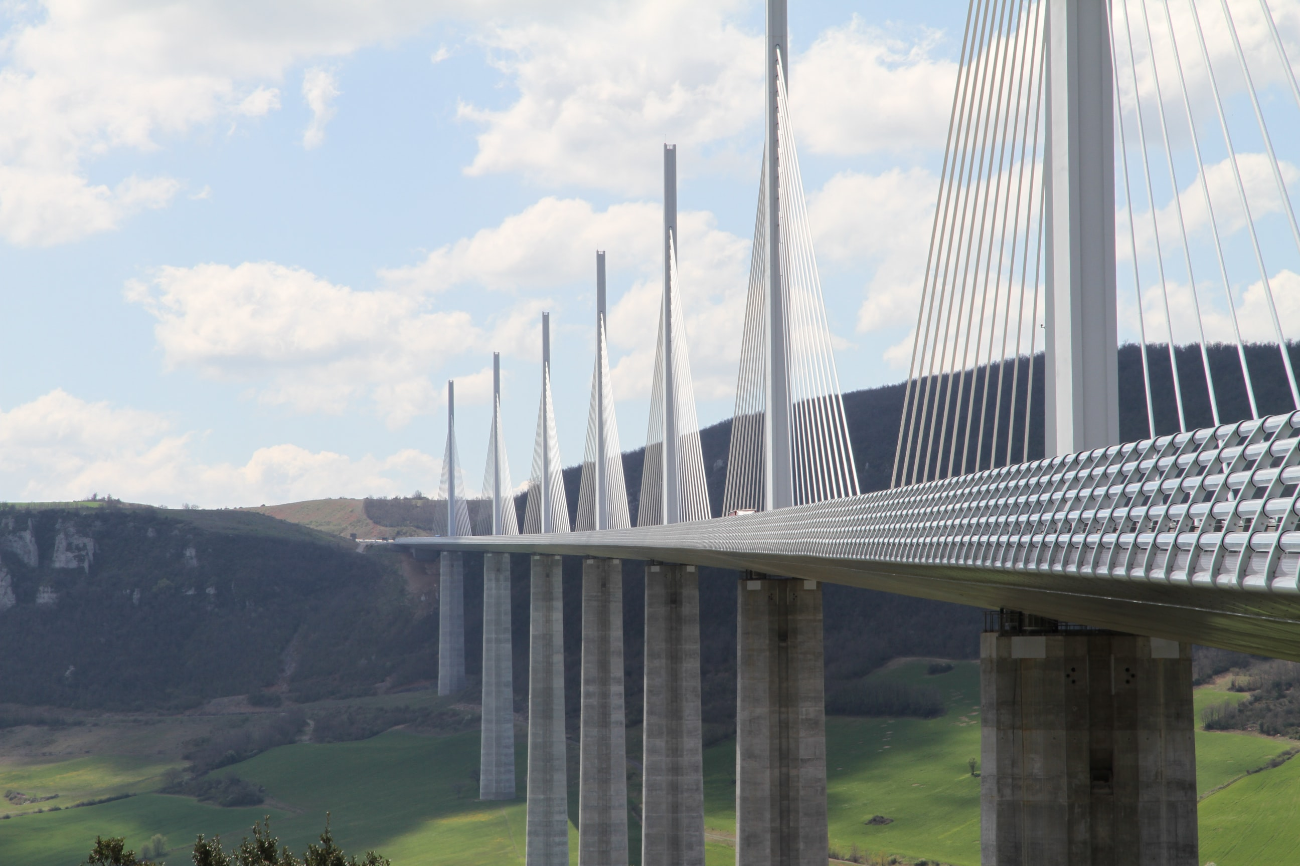 The Viaduc de Millau bridge and mountains against a blue sky