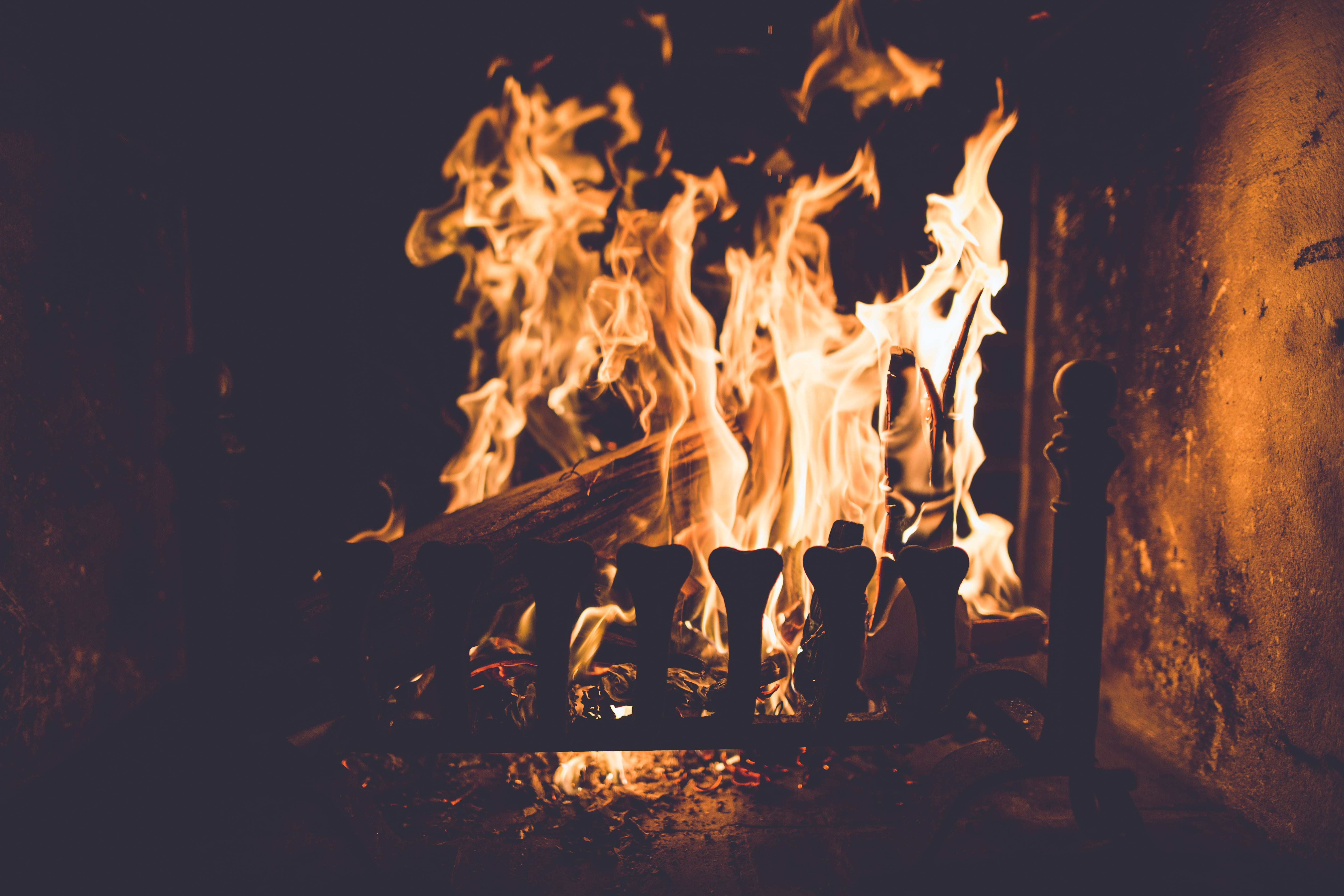 Flames burn a log in an indoor fireplace