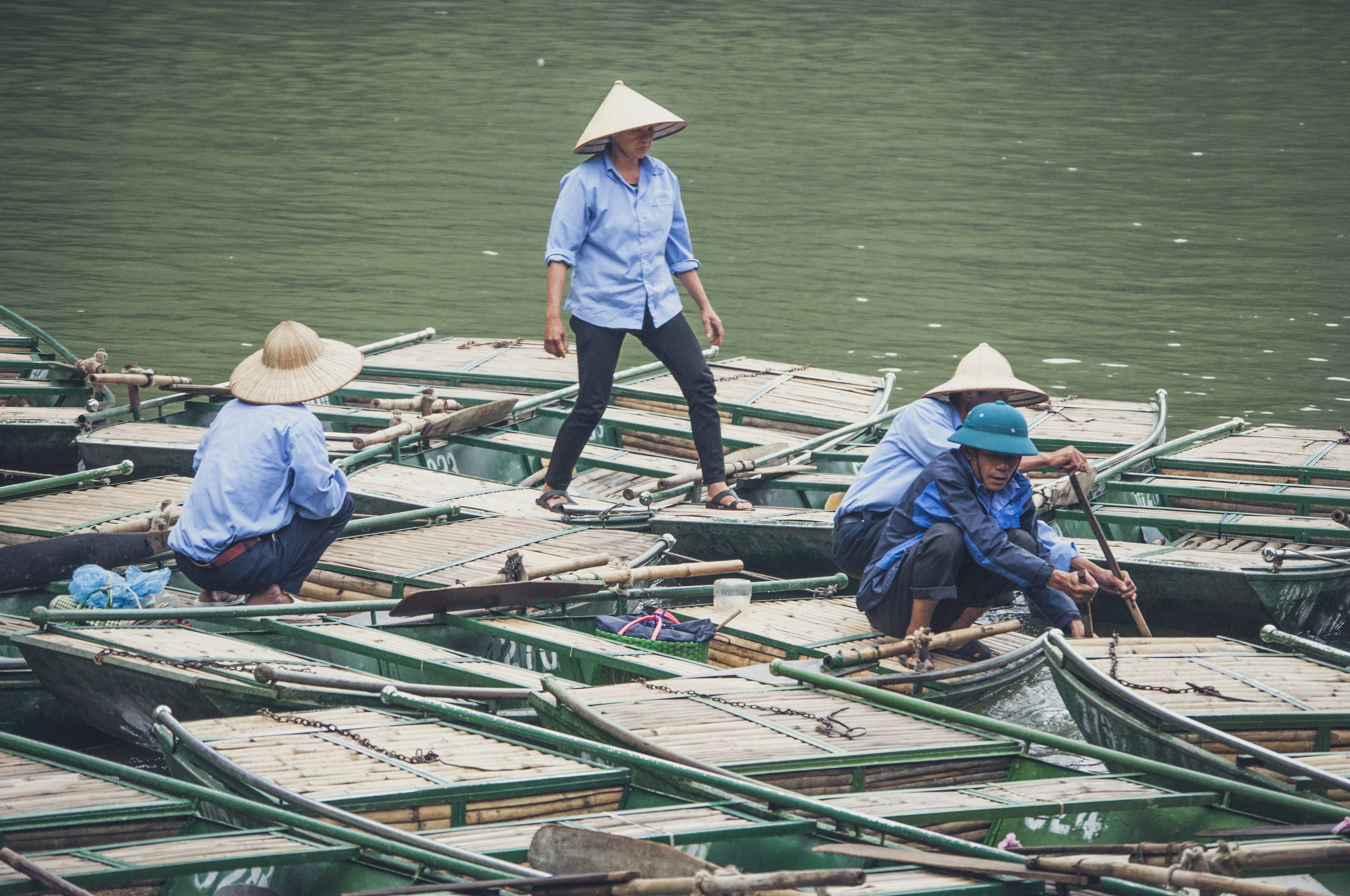 Four fishermen prepare their boats for the day in Vietnam