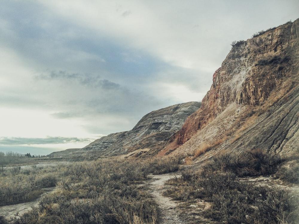 dirt road beside cliff