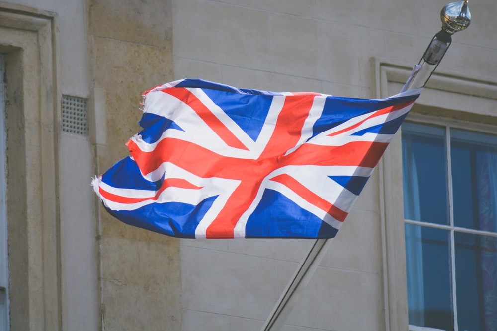 raised United Kingdom flag