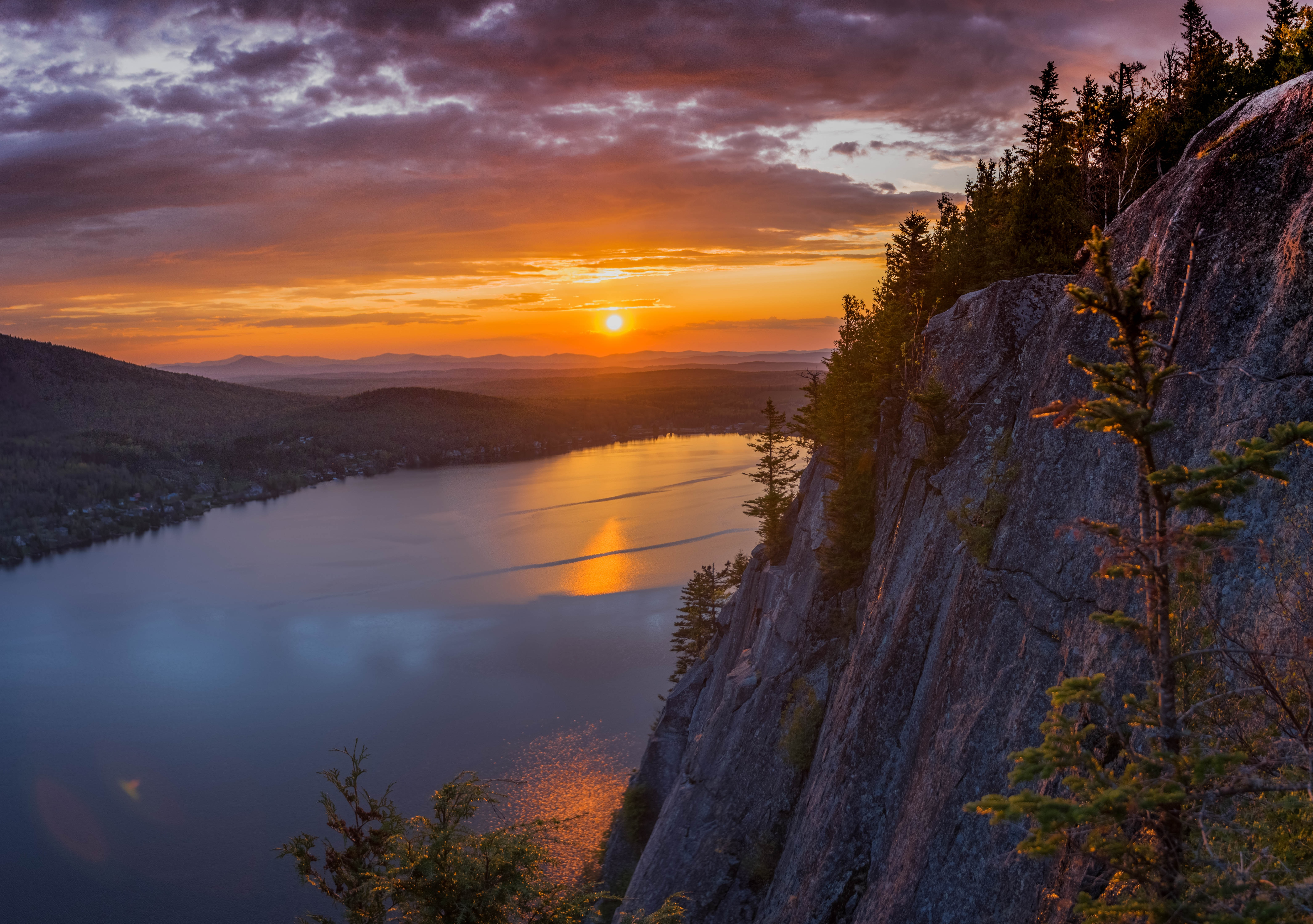 gray cliff near body of water during golden hour