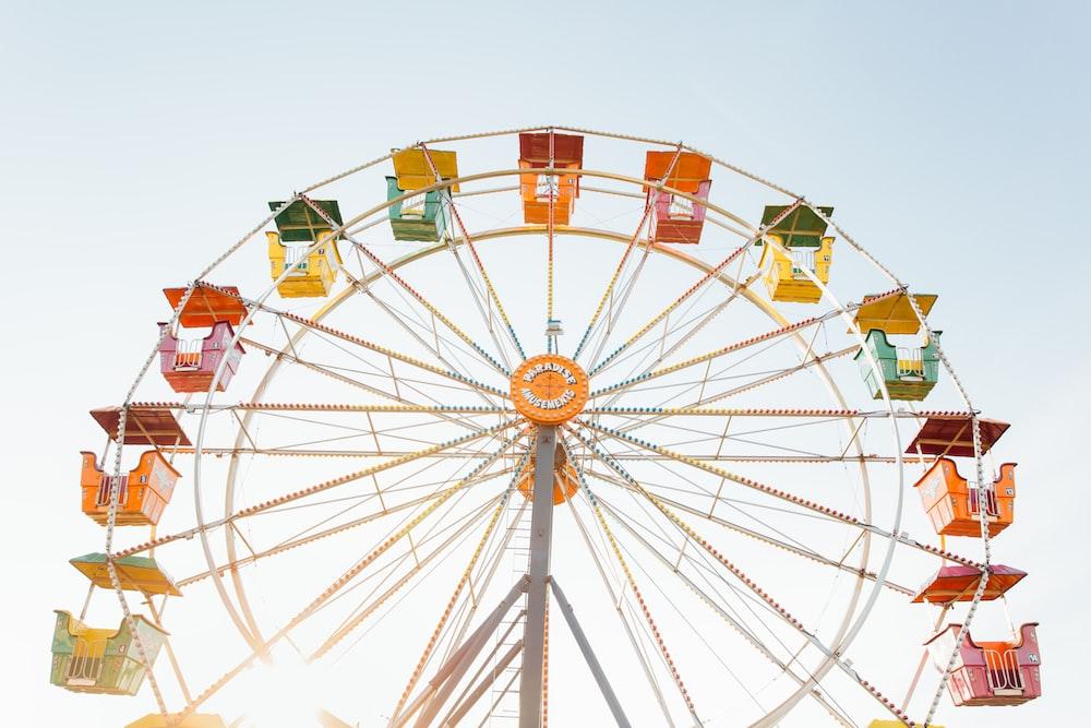 worm's eye view of red, orange, and yellow Ferris wheel
