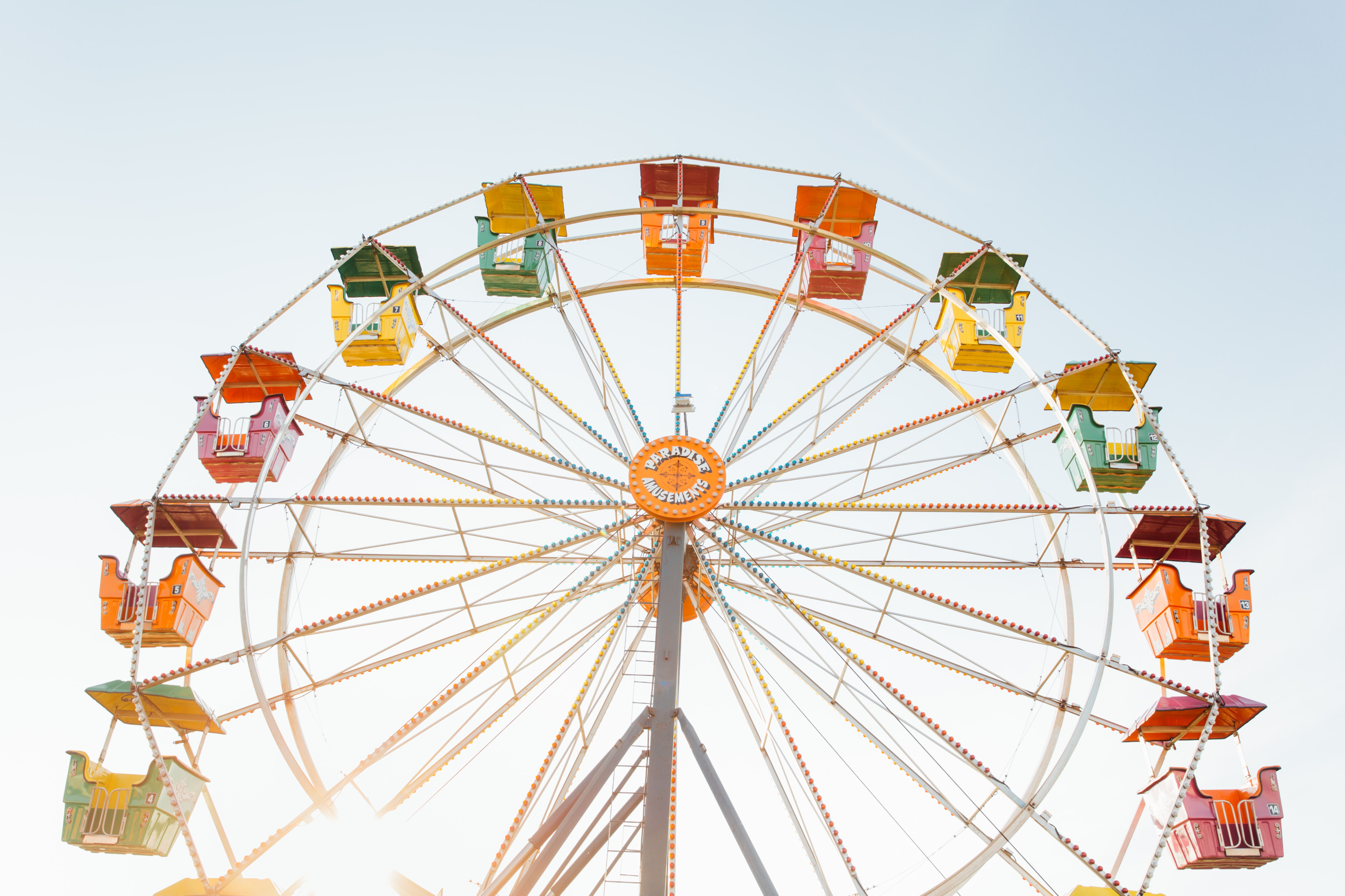 Catch a colorful ride at the huge Cleveland amusement park with  ferriswheel at summer carnival