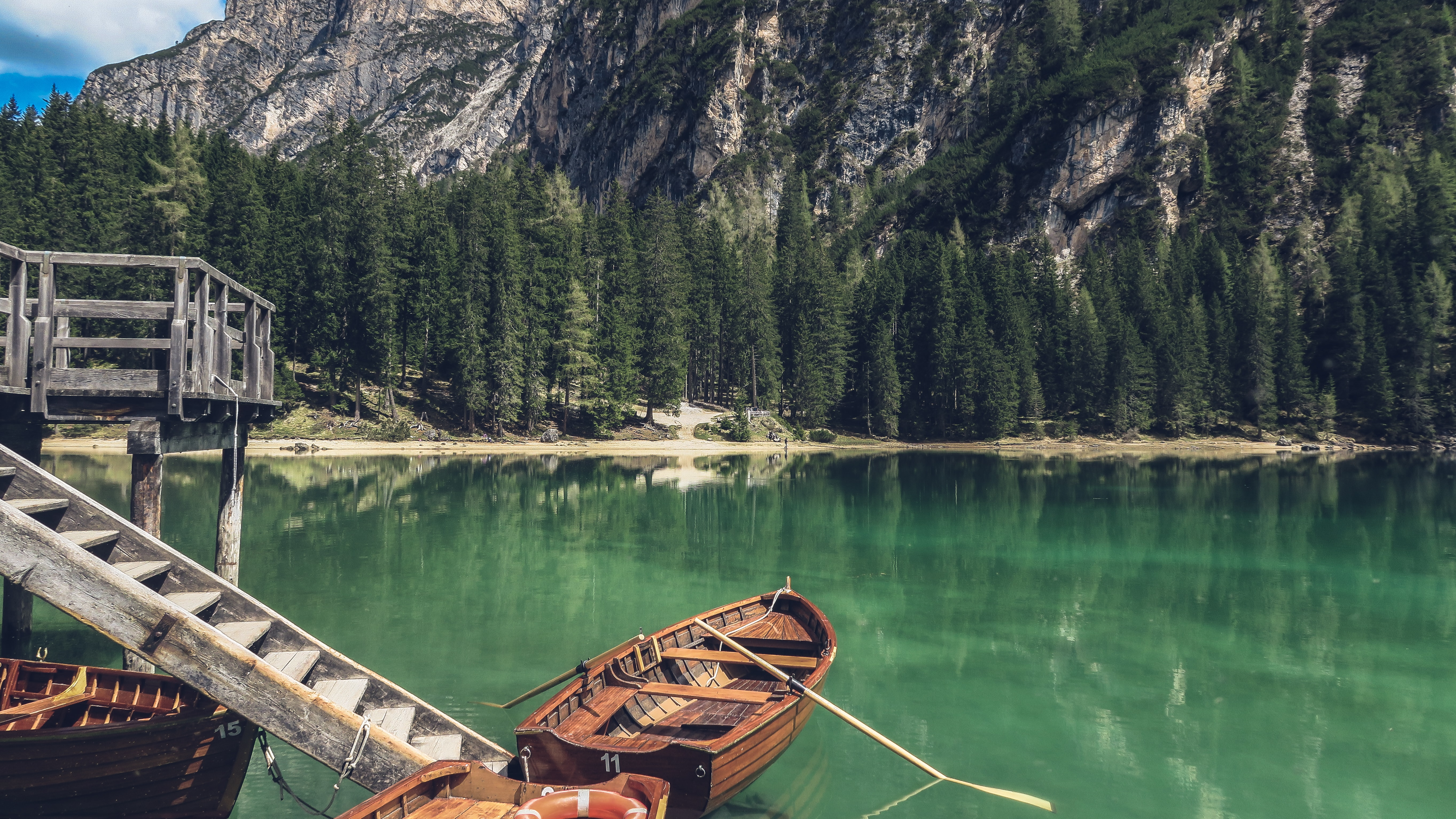 Wooden boats by a jetty on Lake Pragser Wildsee