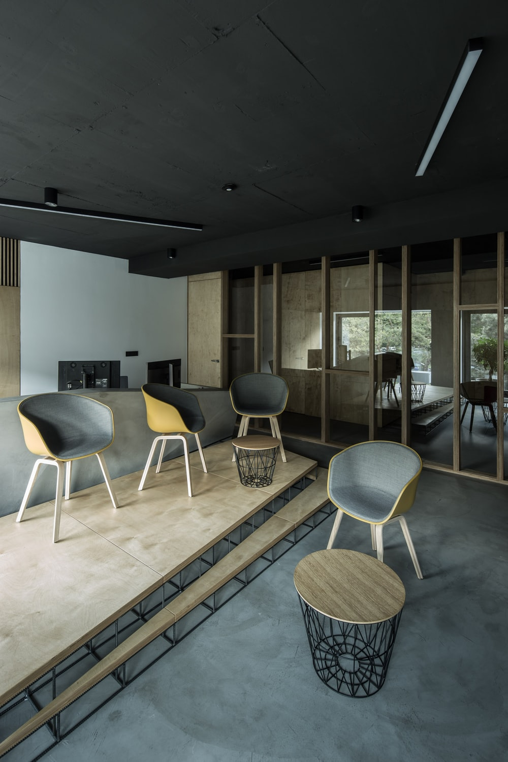 four brown wooden chairs inside house