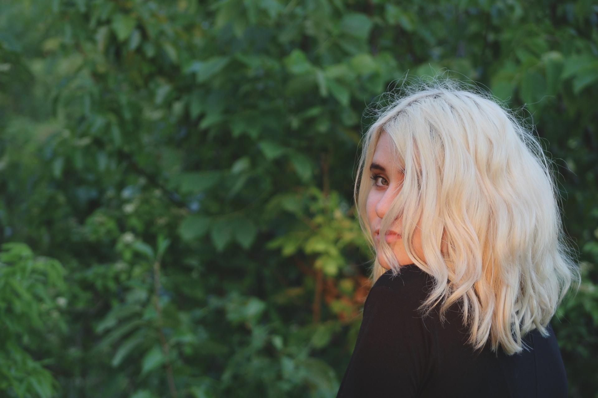woman in black top looking back