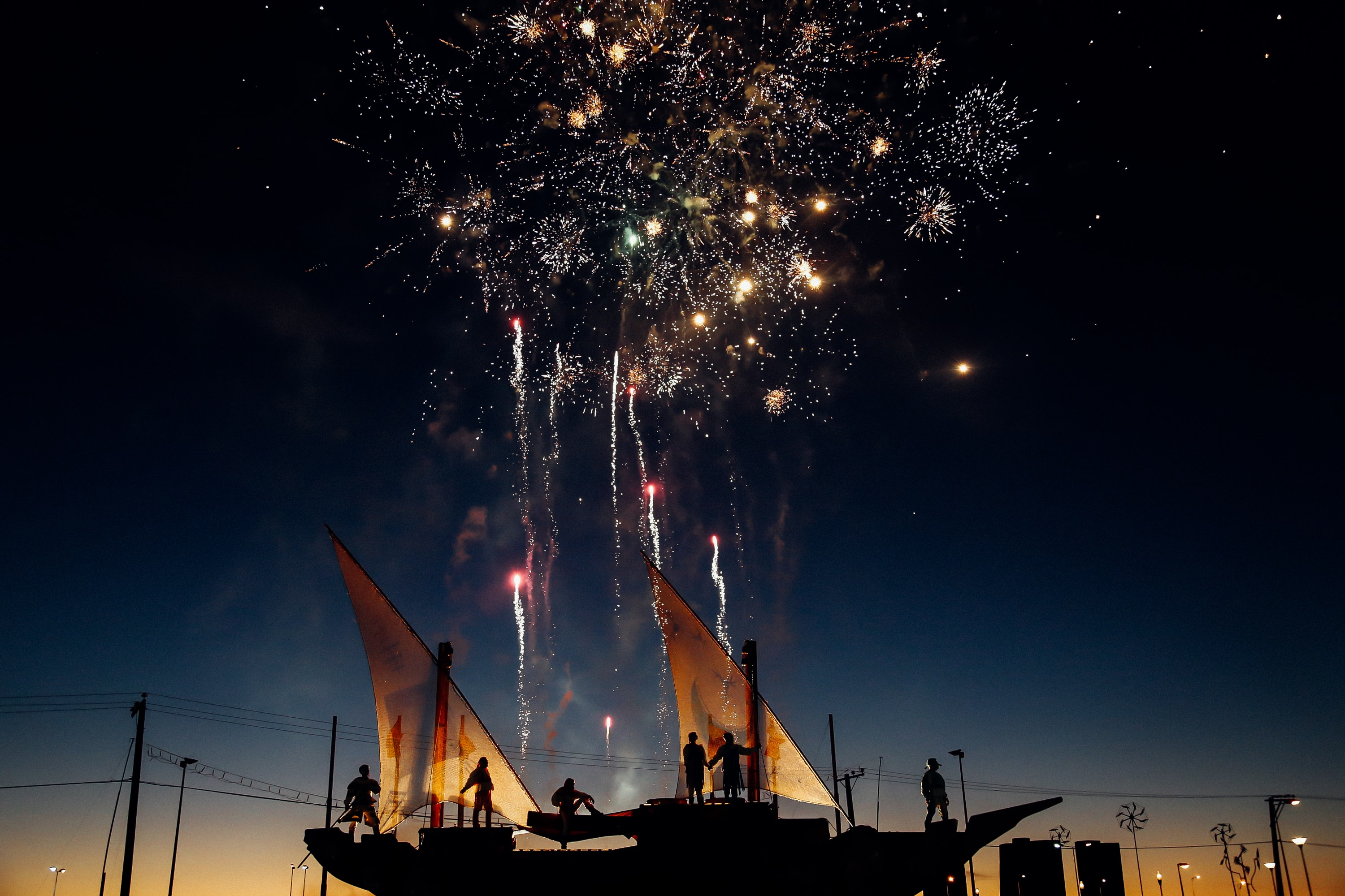 Silhouette of people on a pirate ship watching the fireworks in Concepción