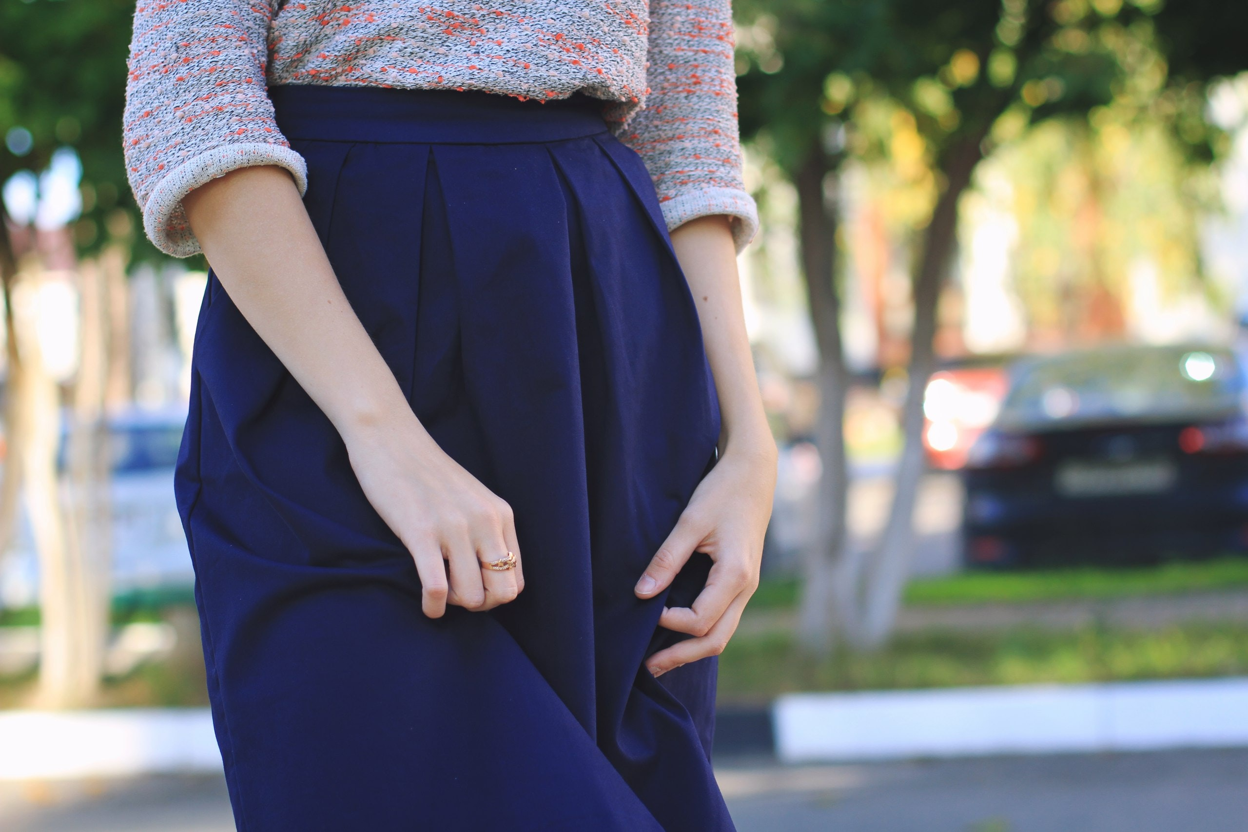 close-up photography of woman wears blue skirt at daytime