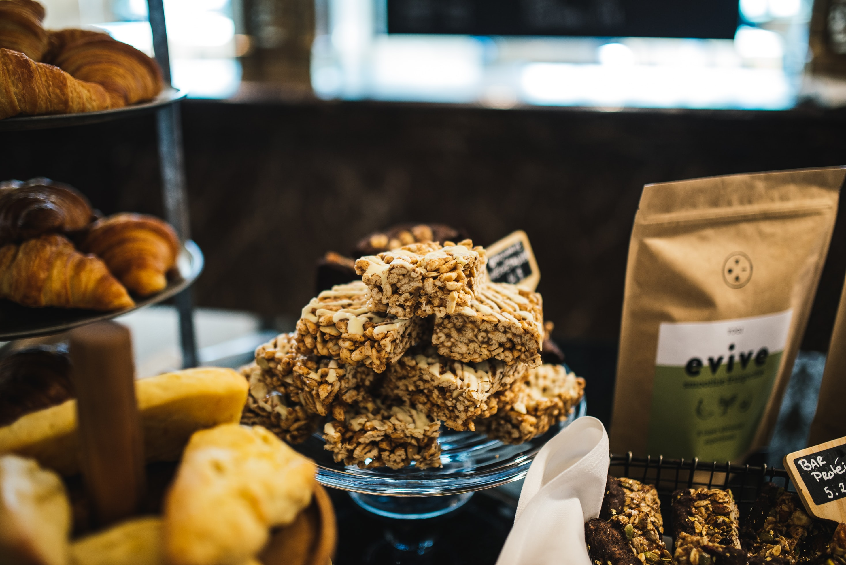 Granola cereal bars and pastries at a cafe bakery